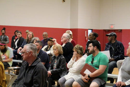 Many members of the audience deviated from the meeting's intended format to raise concerns directly to the panel.