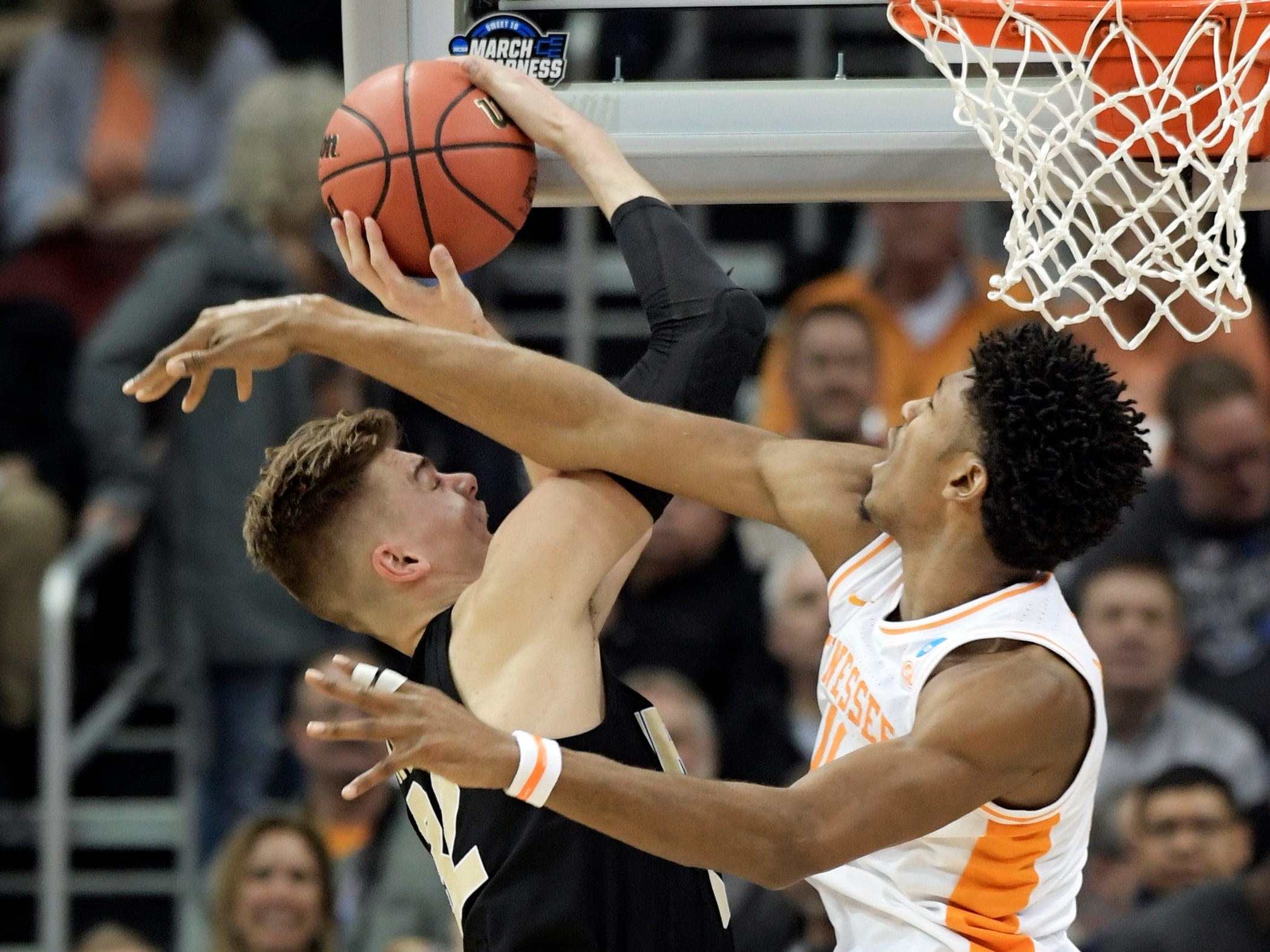 Purdue's Matt Haarms, left, goes to the basket against Tennessee's Kyle Alexander, right, during the first half of a men's NCAA Tournament college basketball South Regional semifinal game Thursday, March 28, 2019, in Louisville, Ky.