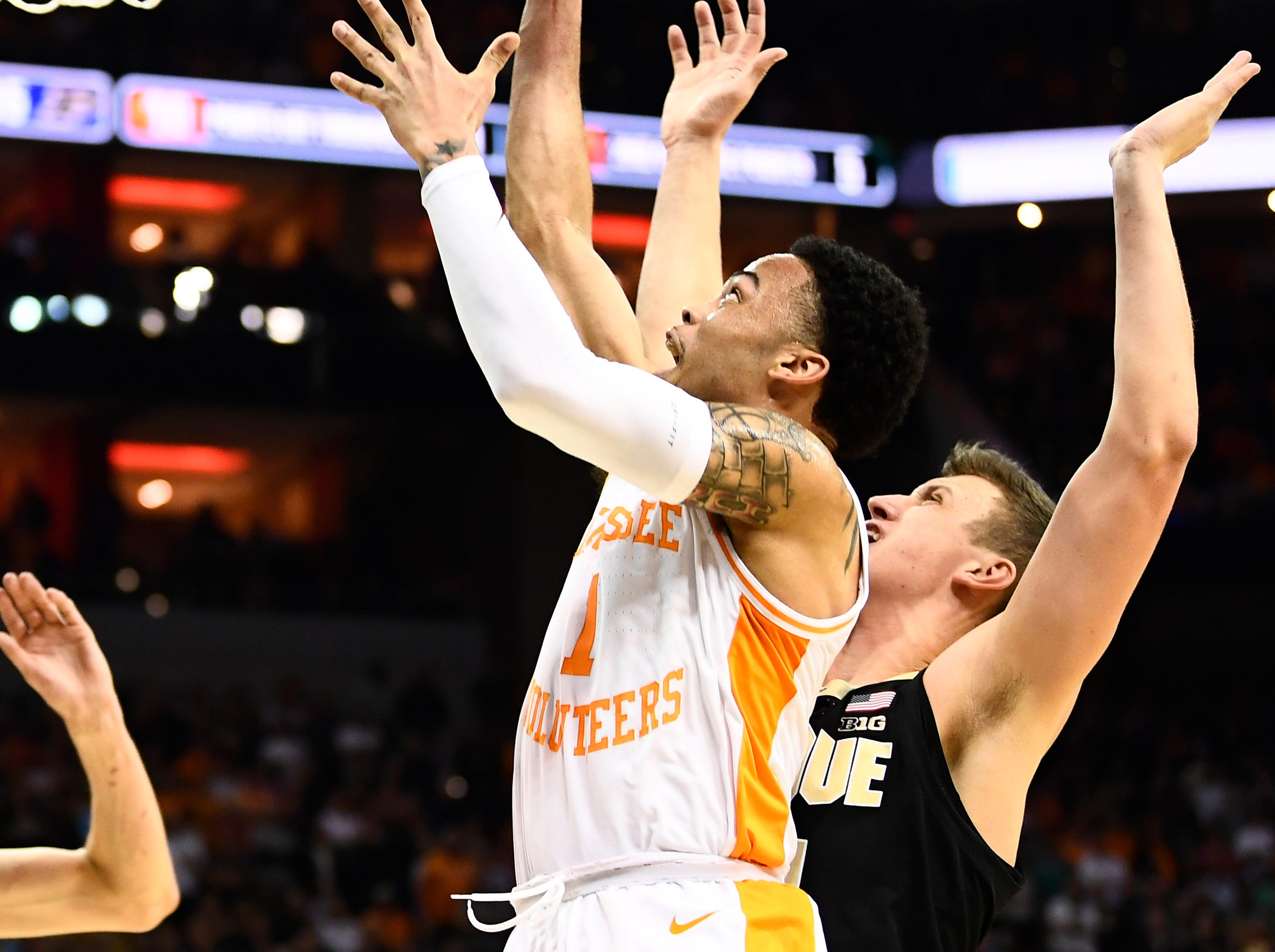 Tennessee guard Lamonte Turner (1) goes up for a shot during the Tennessee VolunteersÕ basketball Sweet 16 game against the Purdue Boilermakers in the NCAA Tournament held at the KFC Yum! Center in Louisville, Ky., on Thursday, March 28, 2019.