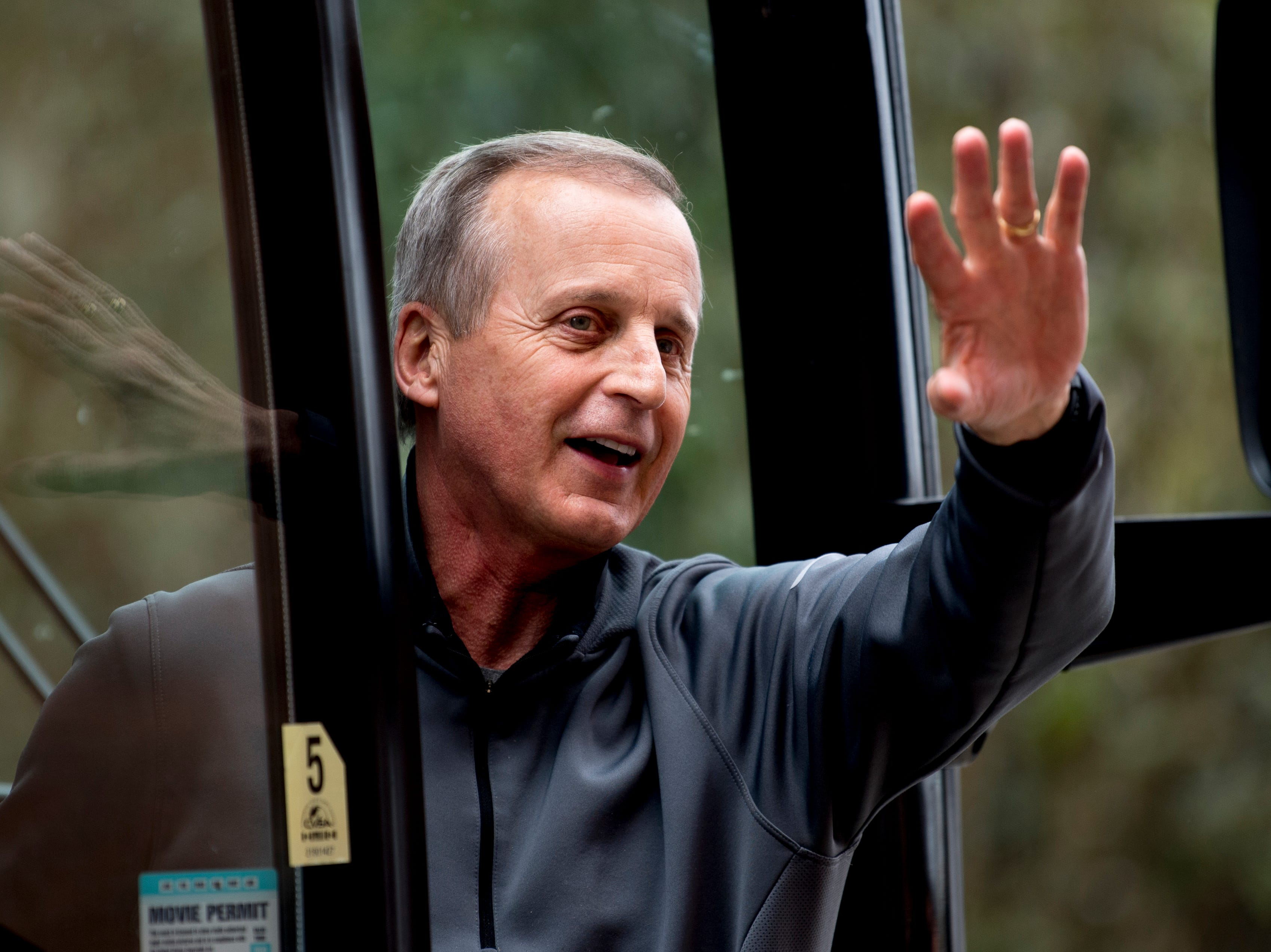 Tennessee Head Coach Rick Barnes waves to fans from the bus upon returning to Stokley Hall in Knoxville, Tennessee on Friday, March 29, 2019. The Vols fell to Purdue Thursday night during the Sweet 16 of the NCAA tournament.