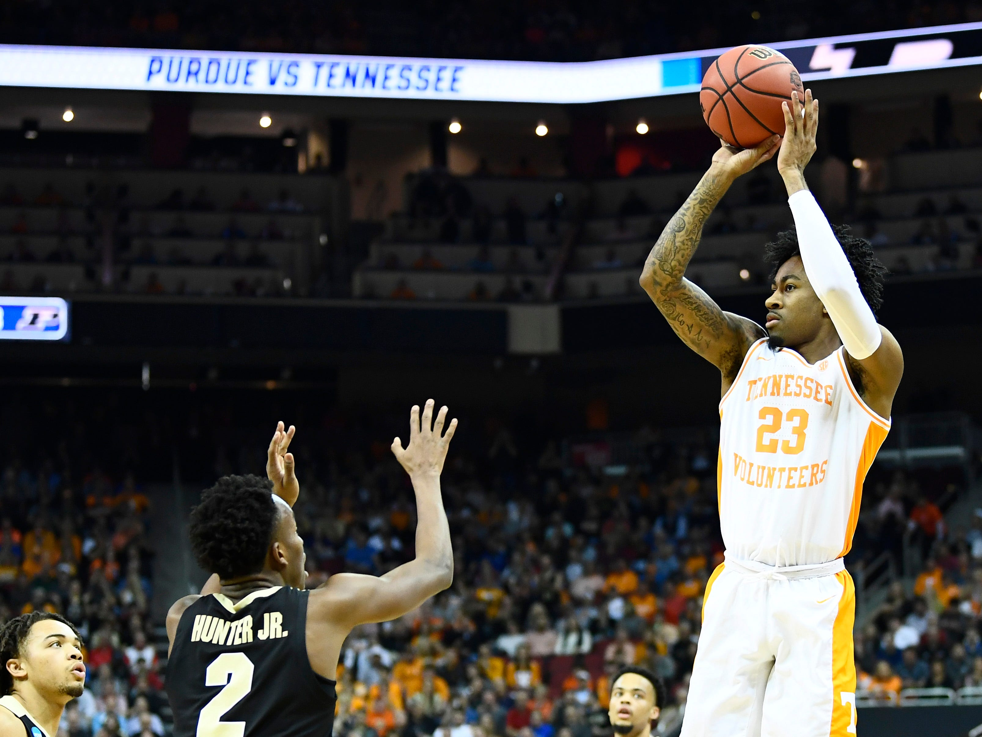 Tennessee guard Jordan Bowden (23) shoots a three-pointer over Purdue guard Eric Hunter Jr. (2) in their Sweet 16 game in the NCAA Tournament Thursday, March 28, 2019, at the KFC Yum! Center in Louisville, Ky.