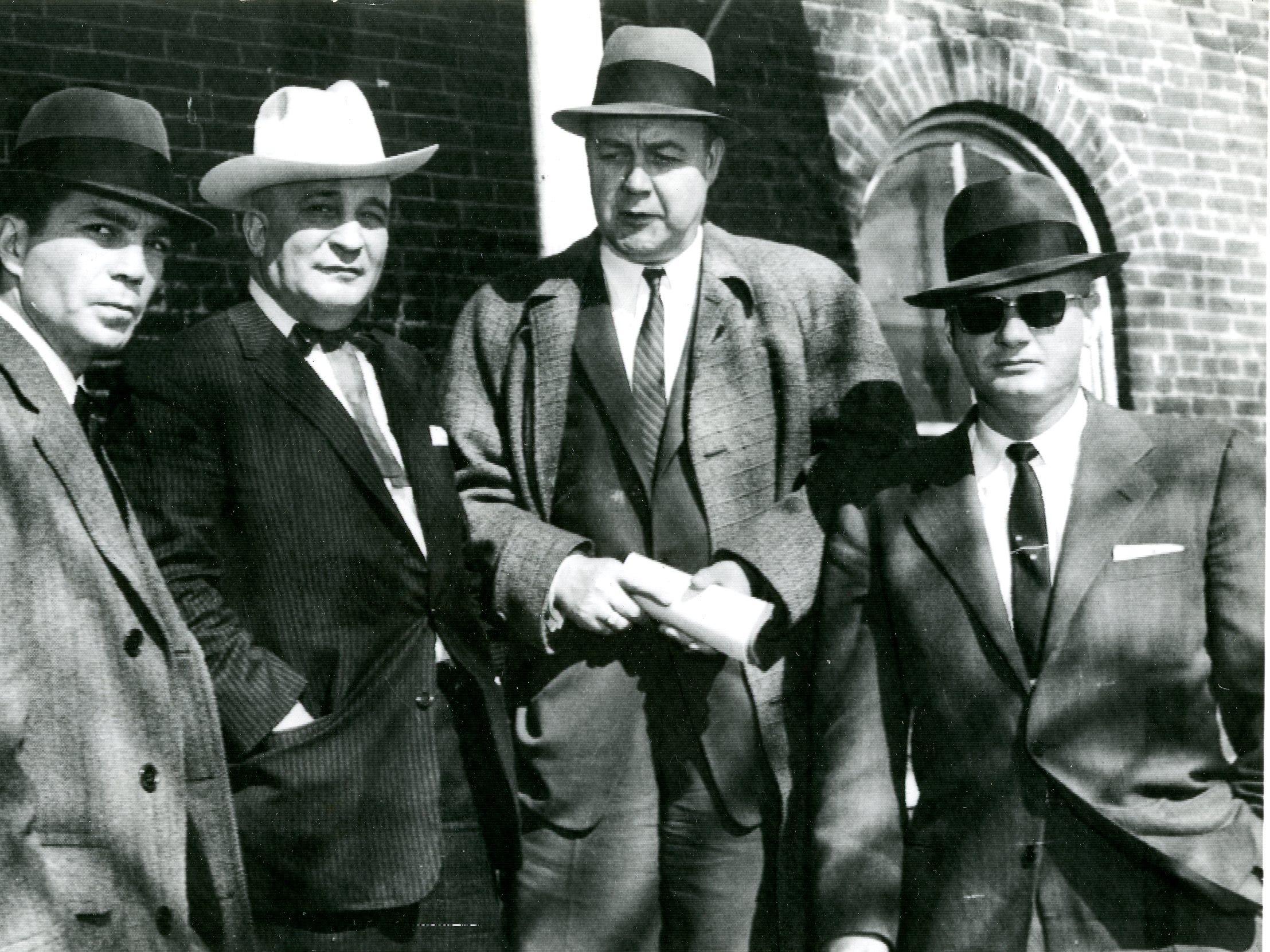 Members of the investigating committee outside the county building at Tracy City, February 21, 1959. Rep. J. Alan Hanover (Memphis), Senator Barton Dement (Murfreesboro), Rep. Harry Lee Senter (Bristol), and Senator Lawrence T. Hughes (Memphis).