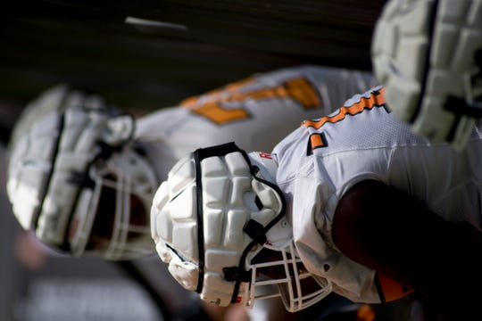 Players line up for a drill during Tennessee spring football practice at Haslam Field in Knoxville, Tennessee on Friday, March 29, 2019.