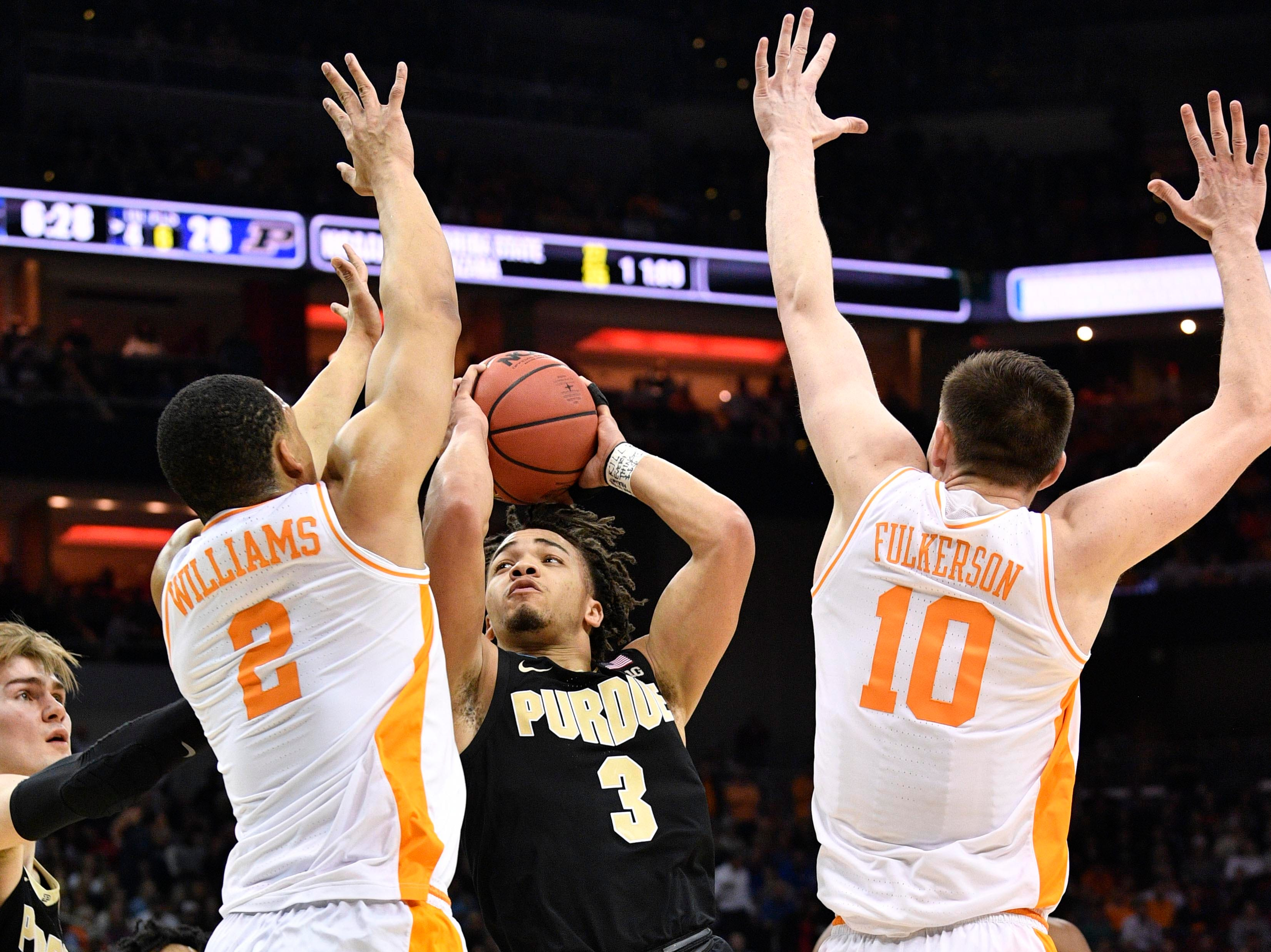 Mar 28, 2019; Louisville, KY, United States; Purdue Boilermakers guard Carsen Edwards (3) shoots as Tennessee Volunteers forward Grant Williams (2) and forward John Fulkerson (10) defend during the first half in the semifinals of the south regional of the 2019 NCAA Tournament at KFC Yum Center. Mandatory Credit: Jamie Rhodes-USA TODAY Sports