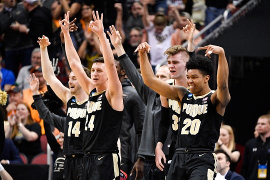 Purdue Boilermakers team members react on the bench during the second half in the semifinals of the south regional against the Tennessee Volunteers of the 2019 NCAA Tournament at KFC Yum Center.