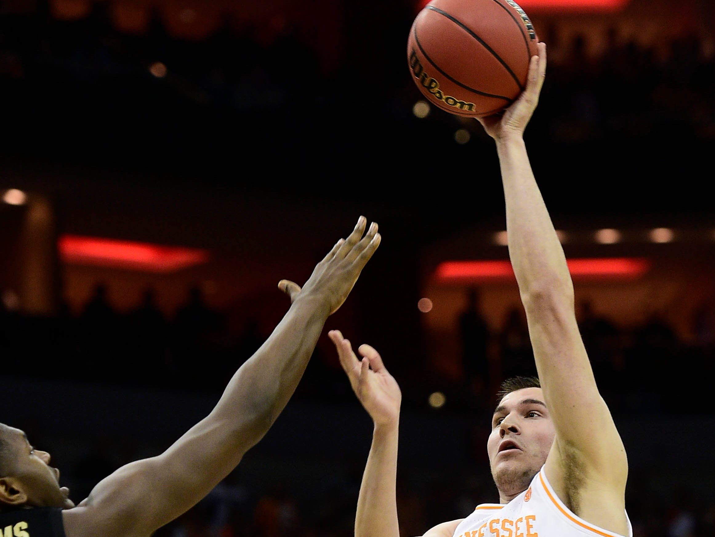 Mar 28, 2019; Louisville, KY, United States; Tennessee Volunteers forward John Fulkerson (10) shoots as Purdue Boilermakers forward Trevion Williams (50) defends during the first half in the semifinals of the south regional of the 2019 NCAA Tournament at KFC Yum Center. Mandatory Credit: Thomas J. Russo-USA TODAY Sports