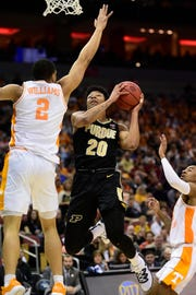 Mar 28, 2019; Louisville, KY, United States; Purdue Boilermakers guard Nojel Eastern (20) goes up for a shot as Tennessee Volunteers forward Grant Williams (2) defends during the second half in the semifinals of the south regional of the 2019 NCAA Tournament at KFC Yum Center. Mandatory Credit: Thomas J. Russo-USA TODAY Sports