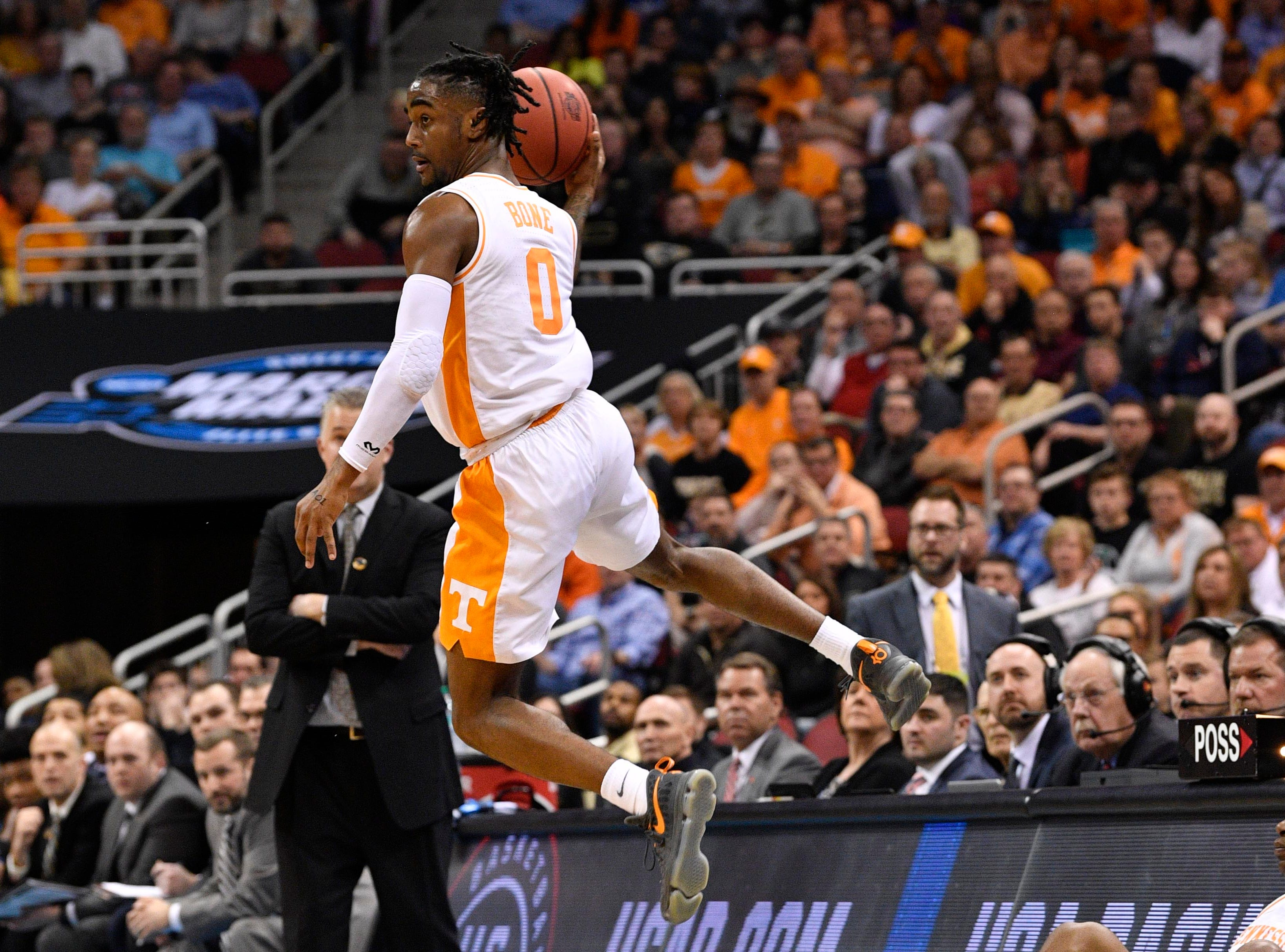 Mar 28, 2019; Louisville, KY, United States; Tennessee Volunteers guard Jordan Bone (0) jumps with the ball during the first half in the semifinals of the south regional against the Purdue Boilermakers of the 2019 NCAA Tournament at KFC Yum Center. Mandatory Credit: Jamie Rhodes-USA TODAY Sports