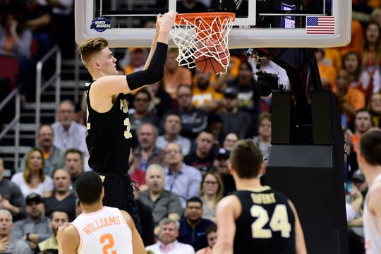 Mar 28, 2019; Louisville, KY, United States; Purdue Boilermakers center Matt Haarms (32) dunks as Tennessee Volunteers forward Grant Williams (2) looks on during the first half in the semifinals of the south regional of the 2019 NCAA Tournament at KFC Yum Center. Mandatory Credit: Thomas J. Russo-USA TODAY Sports