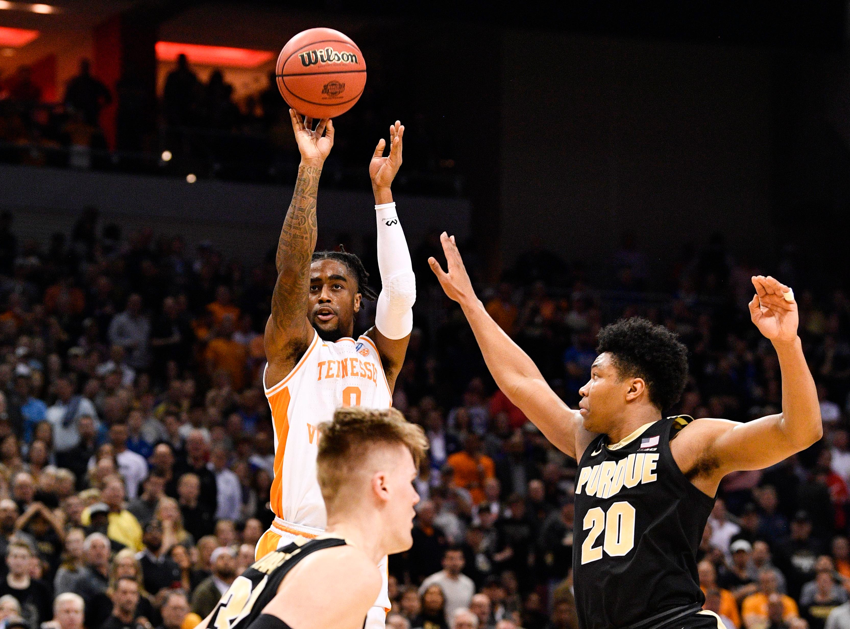 Mar 28, 2019; Louisville, KY, United States; Tennessee Volunteers guard Jordan Bone (0) shoots as Purdue Boilermakers guard Nojel Eastern (20) defends during overtime in the semifinals of the south regional of the 2019 NCAA Tournament at KFC Yum Center. Mandatory Credit: Jamie Rhodes-USA TODAY Sports