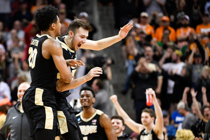 Mar 28, 2019; Louisville, KY, United States; Purdue Boilermakers guard Nojel Eastern (20) and guard Sasha Stefanovic (55) react after defeating the Tennessee Volunteers during overtime in the semifinals of the south regional of the 2019 NCAA Tournament at KFC Yum Center. Mandatory Credit: Jamie Rhodes-USA TODAY Sports