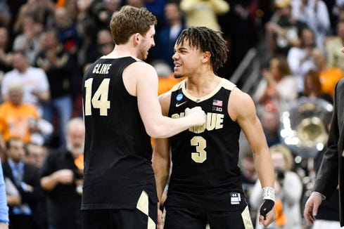 Mar 28, 2019; Louisville, KY, United States; Purdue Boilermakers guard Ryan Cline (14) and guard Carsen Edwards (3) react to their win over the Tennessee Volunteers during overtime in the semifinals of the south regional of the 2019 NCAA Tournament at KFC Yum Center. Mandatory Credit: Jamie Rhodes-USA TODAY Sports