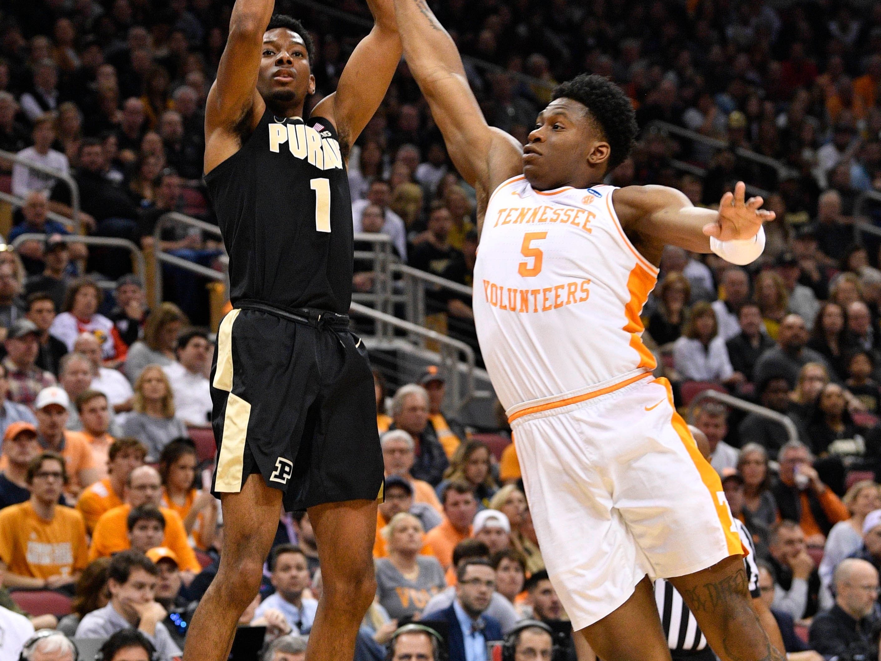 Mar 28, 2019; Louisville, KY, United States; Purdue Boilermakers forward Aaron Wheeler (1) shoots as Tennessee Volunteers guard Admiral Schofield (5) defends during the first half in the semifinals of the south regional of the 2019 NCAA Tournament at KFC Yum Center. Mandatory Credit: Jamie Rhodes-USA TODAY Sports