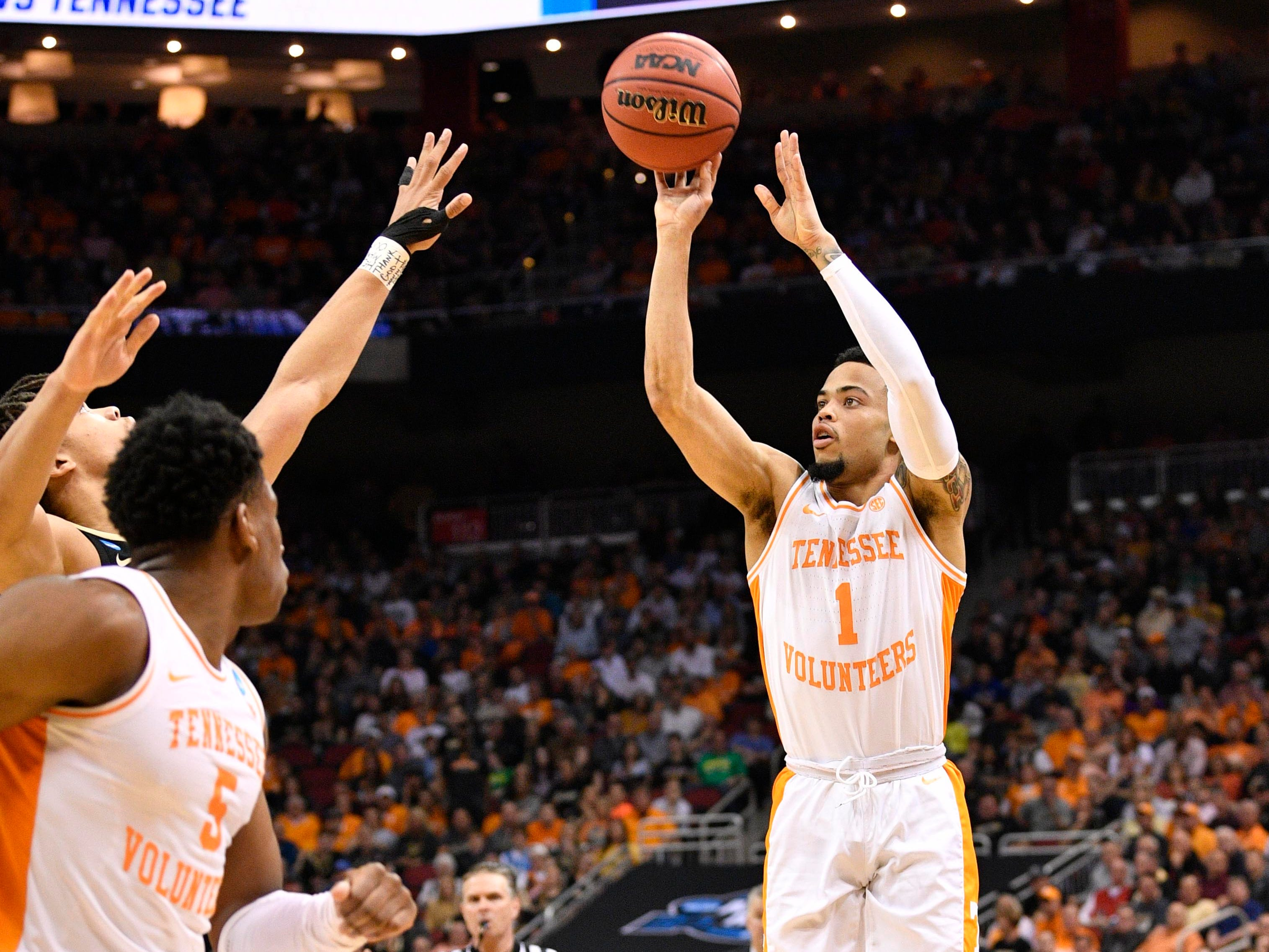 Mar 28, 2019; Louisville, KY, United States; Tennessee Volunteers guard Lamonte Turner (1) shoots during the second half in the semifinals of the south regional against the Purdue Boilermakers of the 2019 NCAA Tournament at KFC Yum Center. Mandatory Credit: Jamie Rhodes-USA TODAY Sports