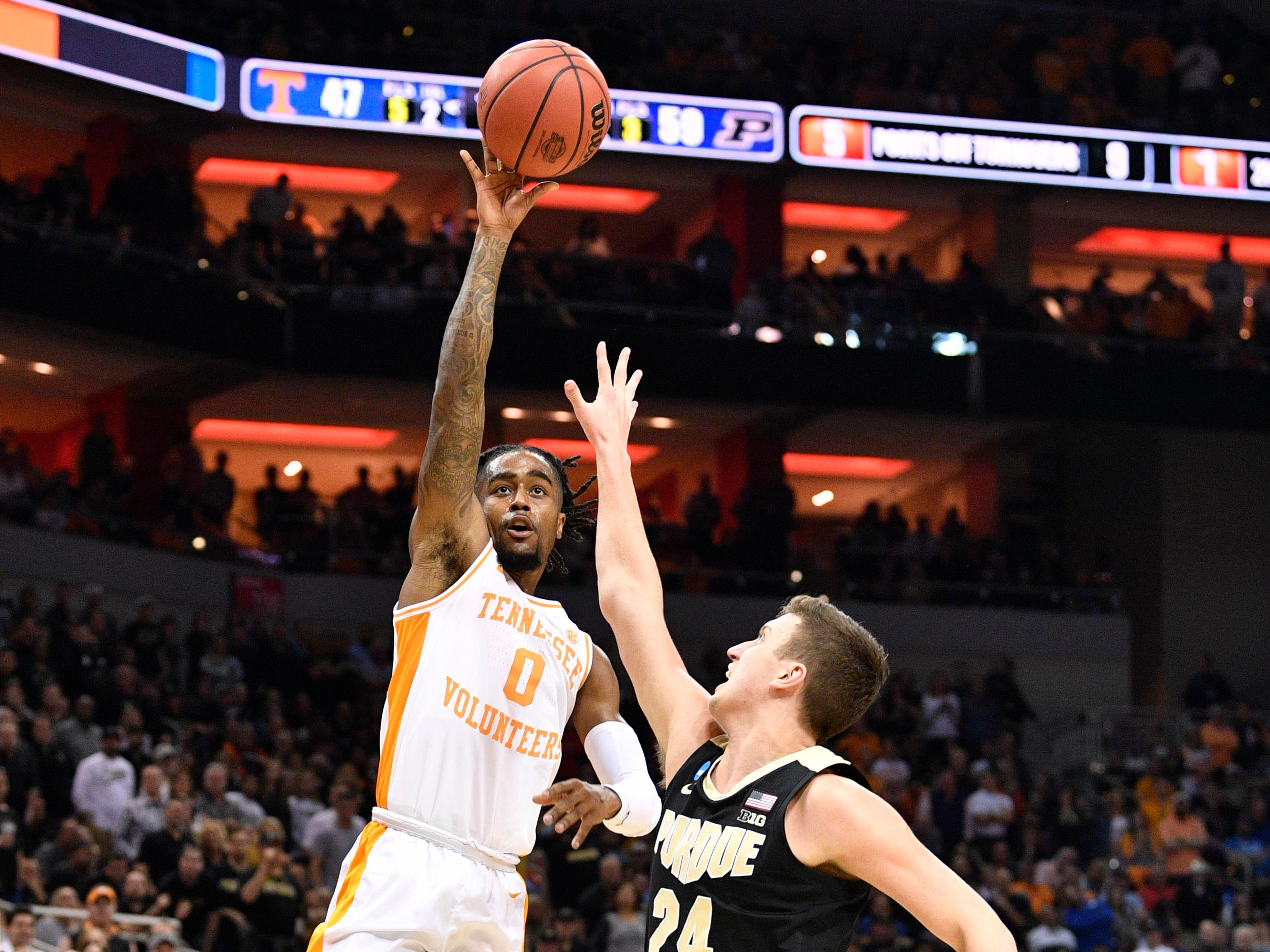 Mar 28, 2019; Louisville, KY, United States; Tennessee Volunteers guard Jordan Bone (0) shoots as Purdue Boilermakers forward Grady Eifert (24) defends during the second half in the semifinals of the south regional of the 2019 NCAA Tournament at KFC Yum Center. Mandatory Credit: Jamie Rhodes-USA TODAY Sports