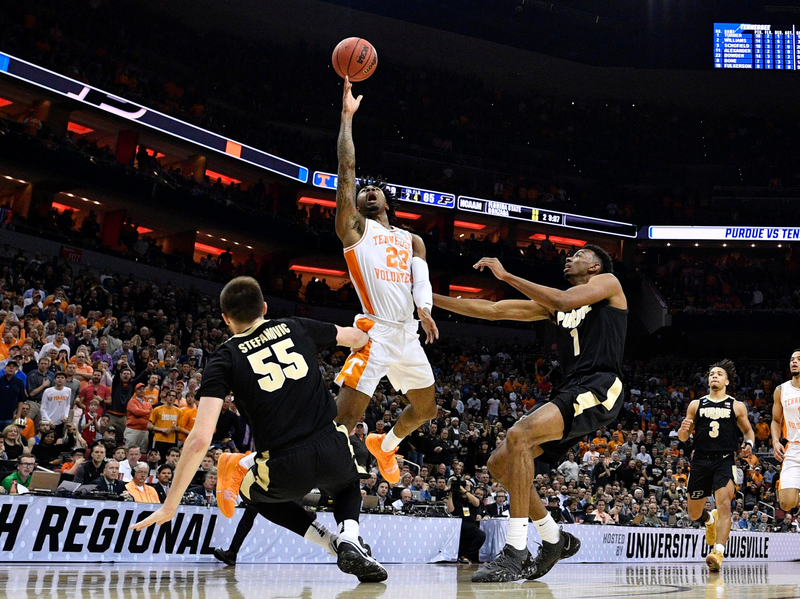 Mar 28, 2019; Louisville, KY, United States; Tennessee Volunteers guard Jordan Bowden (23) shoots as Purdue Boilermakers guard Sasha Stefanovic (55) falls and forward Aaron Wheeler (1) looks on during the second half in the semifinals of the south regional of the 2019 NCAA Tournament at KFC Yum Center. Mandatory Credit: Jamie Rhodes-USA TODAY Sports