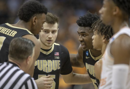 Purdue players huddle up near the end of the game against Tennessee, NCAA Division 1 Men's Basketball 'Sweet Sixteen' game, KFC Yum Center, Louisville, Thursday, March 28, 2019. Purdue beat Tennessee 99-94.