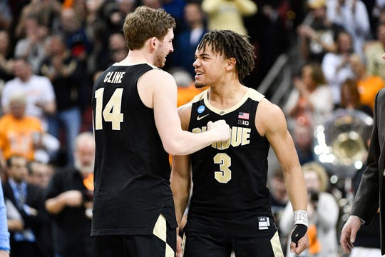 Purdue Boilermakers guard Ryan Cline (14) and guard Carsen Edwards (3) react to their win over the Tennessee Volunteers during overtime in the semifinals of the south regional of the 2019 NCAA Tournament at KFC Yum Center.