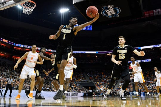Mar 28, 2019; Louisville, KY, United States; Purdue Boilermakers forward Aaron Wheeler (1) grabs a rebound ahead of Tennessee Volunteers forward Grant Williams (2) during the second half in the semifinals of the south regional of the 2019 NCAA Tournament at KFC Yum Center. Mandatory Credit: Jamie Rhodes-USA TODAY Sports