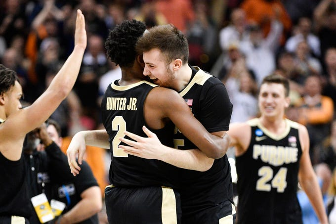Mar 28, 2019; Louisville, KY, United States; Purdue Boilermakers guard Eric Hunter Jr. (2) and guard Sasha Stefanovic (55) react to the win over the Tennessee Volunteers during overtime in the semifinals of the south regional of the 2019 NCAA Tournament at KFC Yum Center. Mandatory Credit: Jamie Rhodes-USA TODAY Sports
