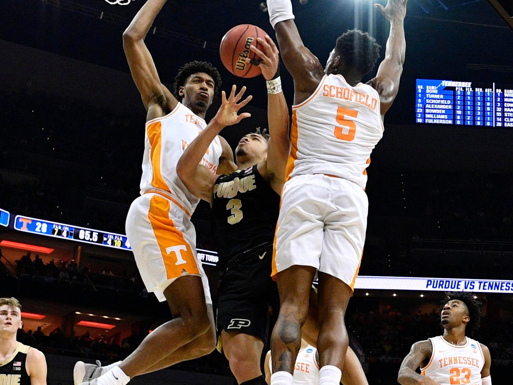 Mar 28, 2019; Louisville, KY, United States; Purdue Boilermakers guard Carsen Edwards (3) goes up for a shot as Tennessee Volunteers forward Kyle Alexander (11) and guard Admiral Schofield (5) defend during the first half in the semifinals of the south regional of the 2019 NCAA Tournament at KFC Yum Center. Mandatory Credit: Jamie Rhodes-USA TODAY Sports