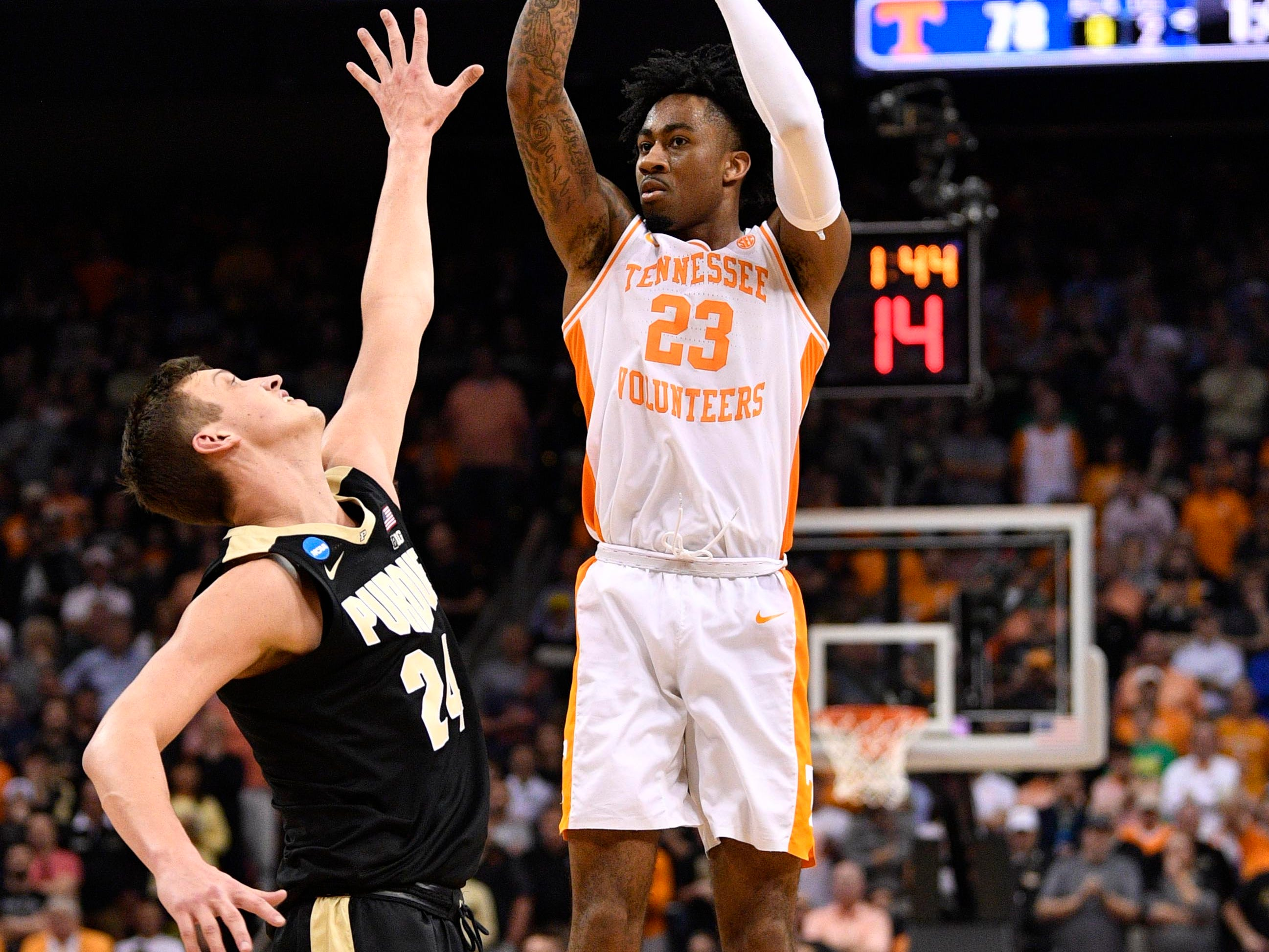 Mar 28, 2019; Louisville, KY, United States; Tennessee Volunteers guard Jordan Bowden (23) shoots as Purdue Boilermakers forward Grady Eifert (24) defends during the second half in the semifinals of the south regional of the 2019 NCAA Tournament at KFC Yum Center. Mandatory Credit: Jamie Rhodes-USA TODAY Sports