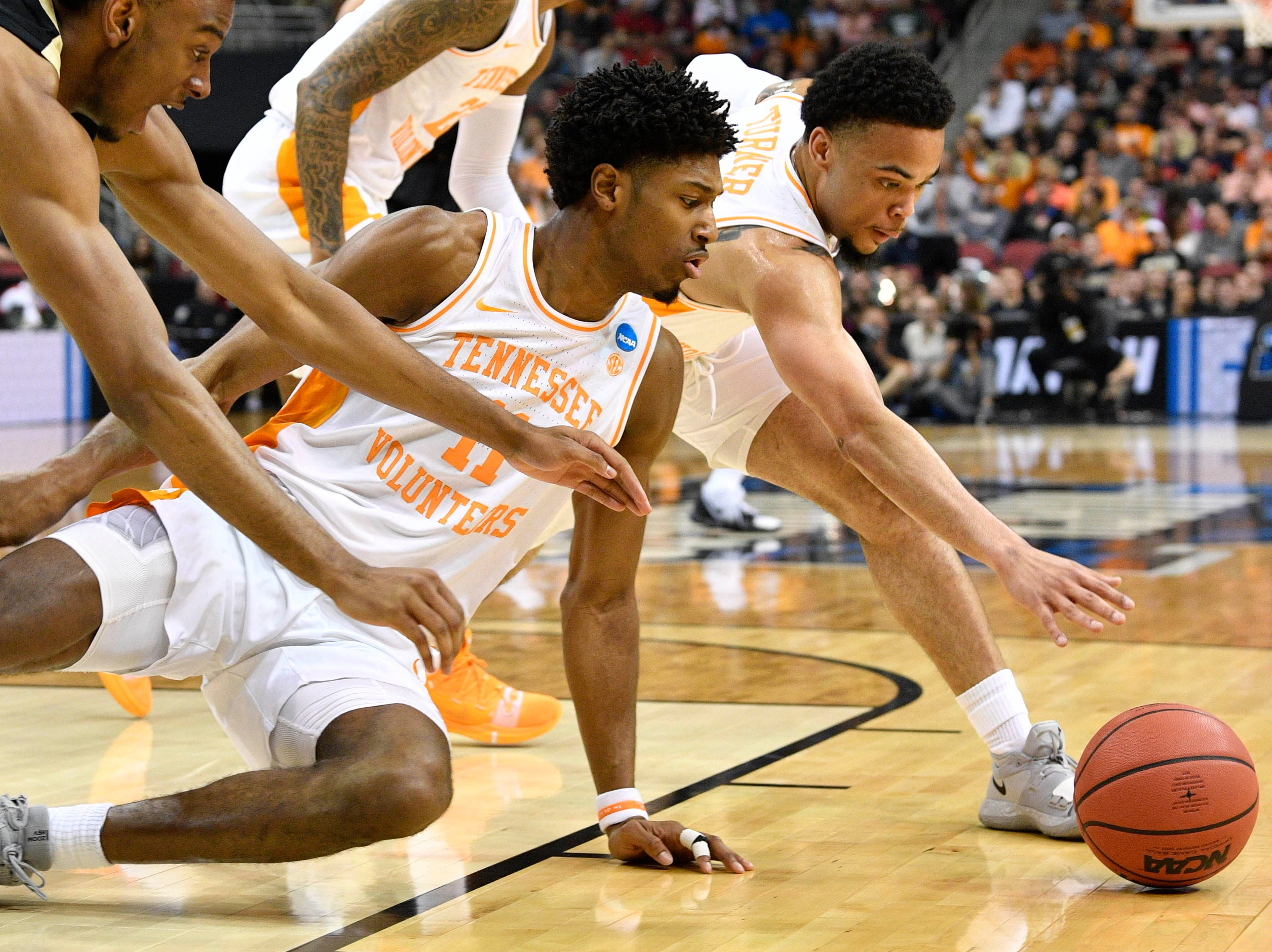 Mar 28, 2019; Louisville, KY, United States; Tennessee Volunteers guard Lamonte Turner (1) and forward Kyle Alexander (11) go after a loose ball during the first half in the semifinals of the south regional against the Purdue Boilermakers of the 2019 NCAA Tournament at KFC Yum Center. Mandatory Credit: Jamie Rhodes-USA TODAY Sports
