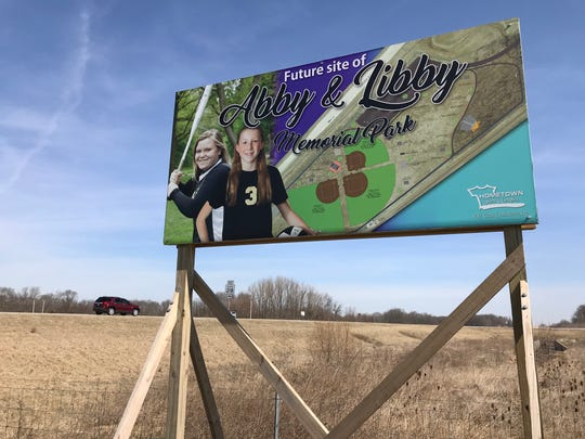 A sign marks 20 acres of what will become Abby & Libby Memorial Park, near the corner of the Hoosier Heartland Highway and Indiana 218, a mile north of Delphi, on Wednesday, March 27, 2019. The park will be a memorial to Abby Williams and Libby German, two Delphi eighth-graders murdered while hiking a popular community trail near Delphi on Feb. 13, 2017.