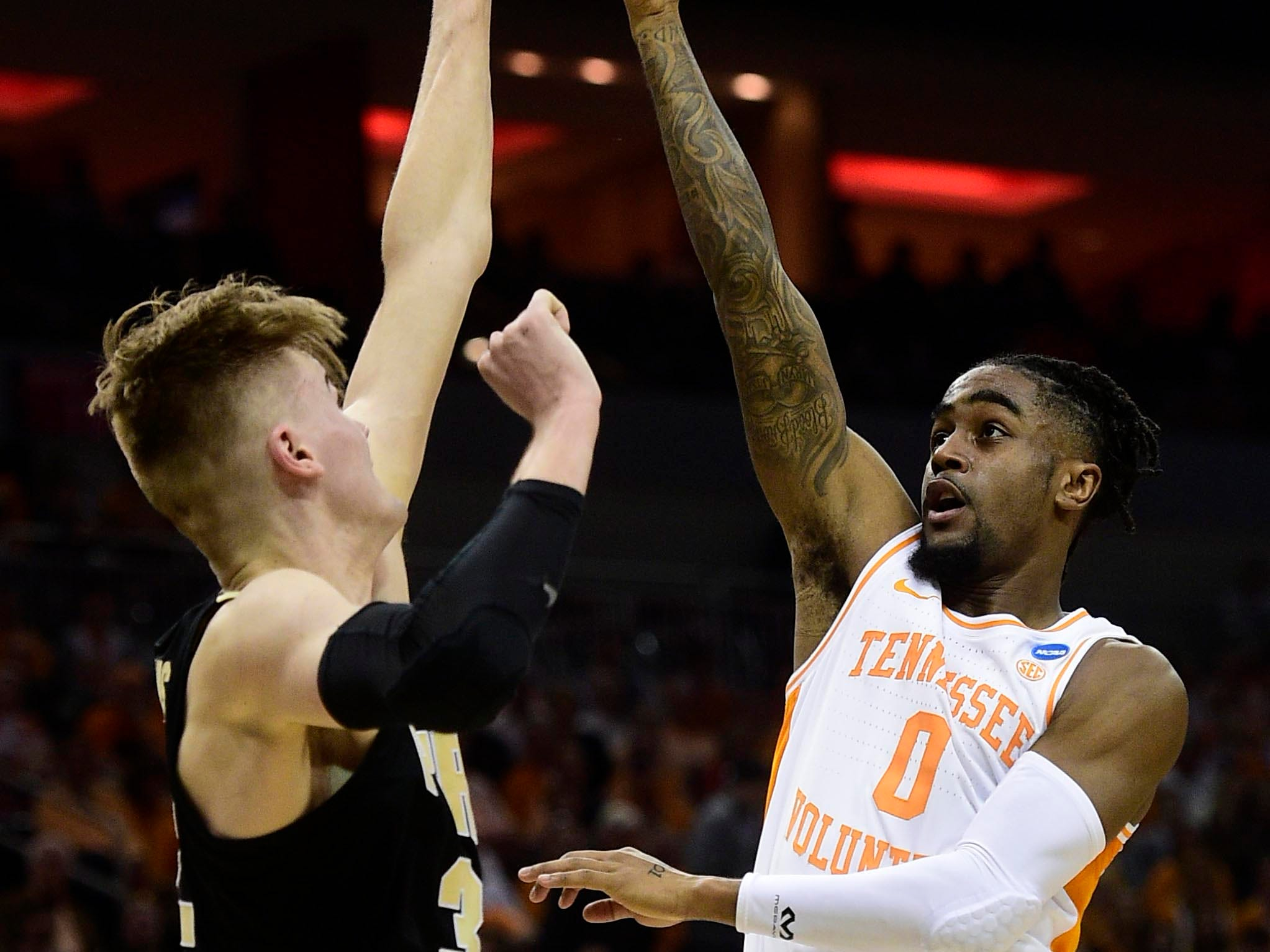 Mar 28, 2019; Louisville, KY, United States; Tennessee Volunteers guard Jordan Bone (0) goes up for a shot as Purdue Boilermakers center Matt Haarms (32) defends during the first half in the semifinals of the south regional of the 2019 NCAA Tournament at KFC Yum Center. Mandatory Credit: Thomas J. Russo-USA TODAY Sports