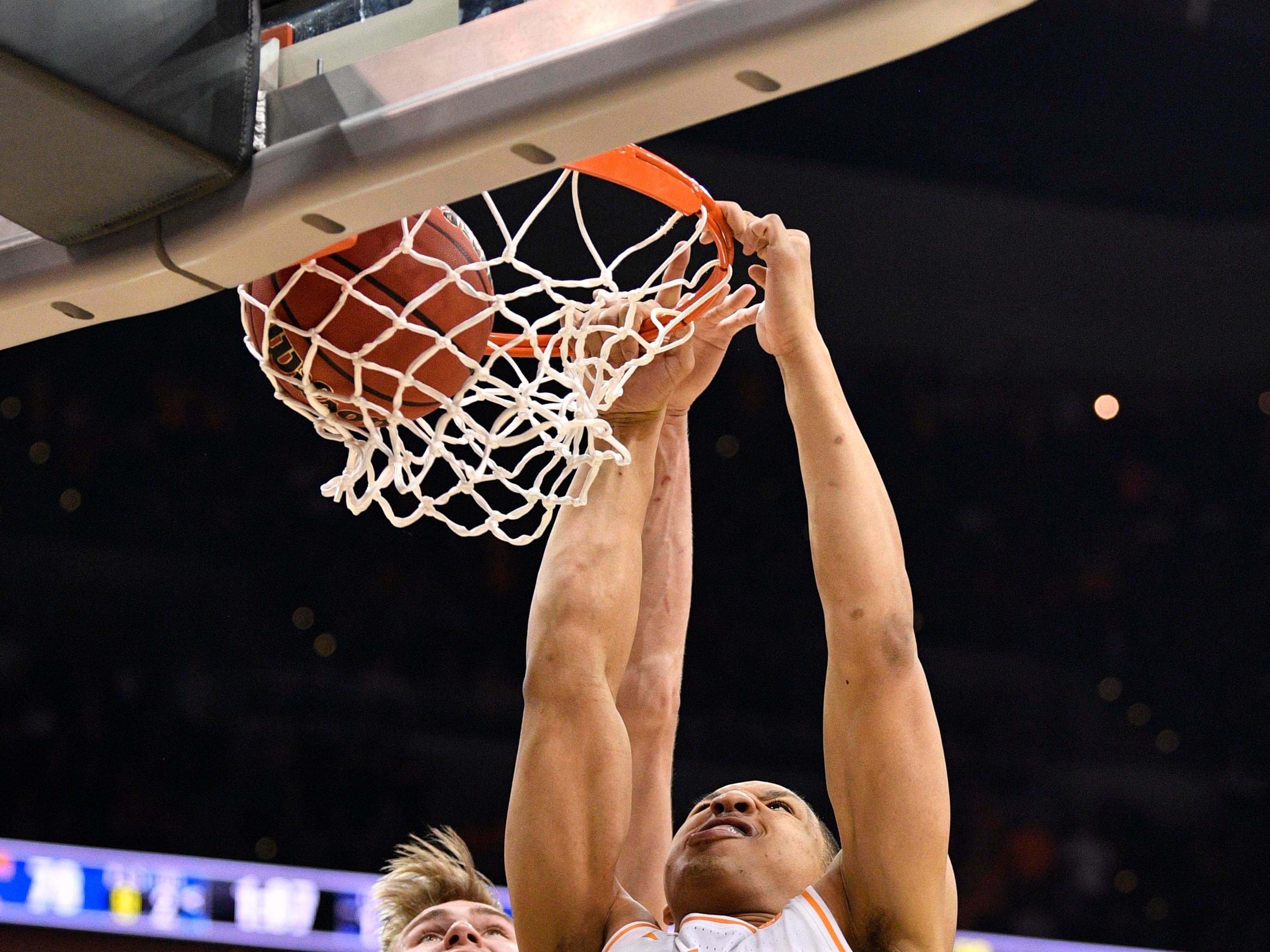 Mar 28, 2019; Louisville, KY, United States; Tennessee Volunteers forward Grant Williams (2) dunks as Purdue Boilermakers center Matt Haarms (32) defends during the second half in the semifinals of the south regional of the 2019 NCAA Tournament at KFC Yum Center. Mandatory Credit: Jamie Rhodes-USA TODAY Sports