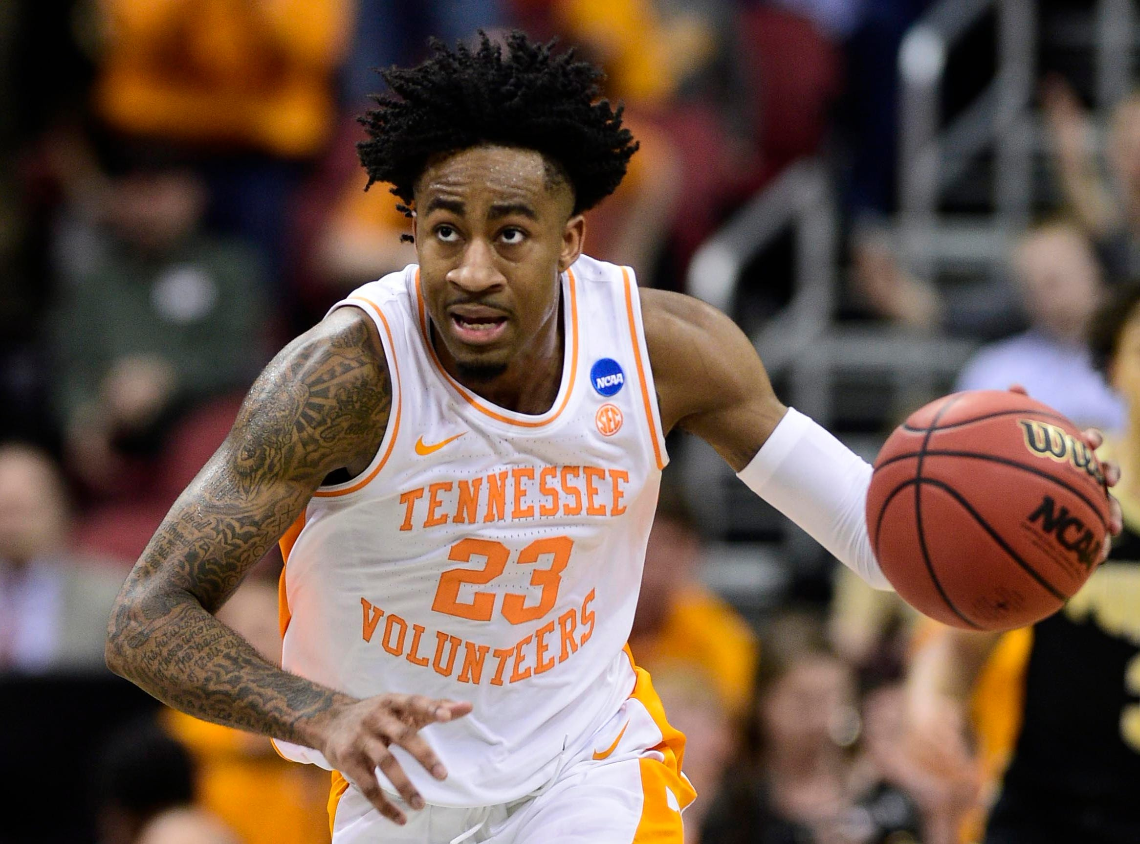Mar 28, 2019; Louisville, KY, United States; Tennessee Volunteers guard Jordan Bowden (23) brings the ball up court during the first half in the semifinals of the south regional against the Purdue Boilermakers of the 2019 NCAA Tournament at KFC Yum Center. Mandatory Credit: Thomas J. Russo-USA TODAY Sports