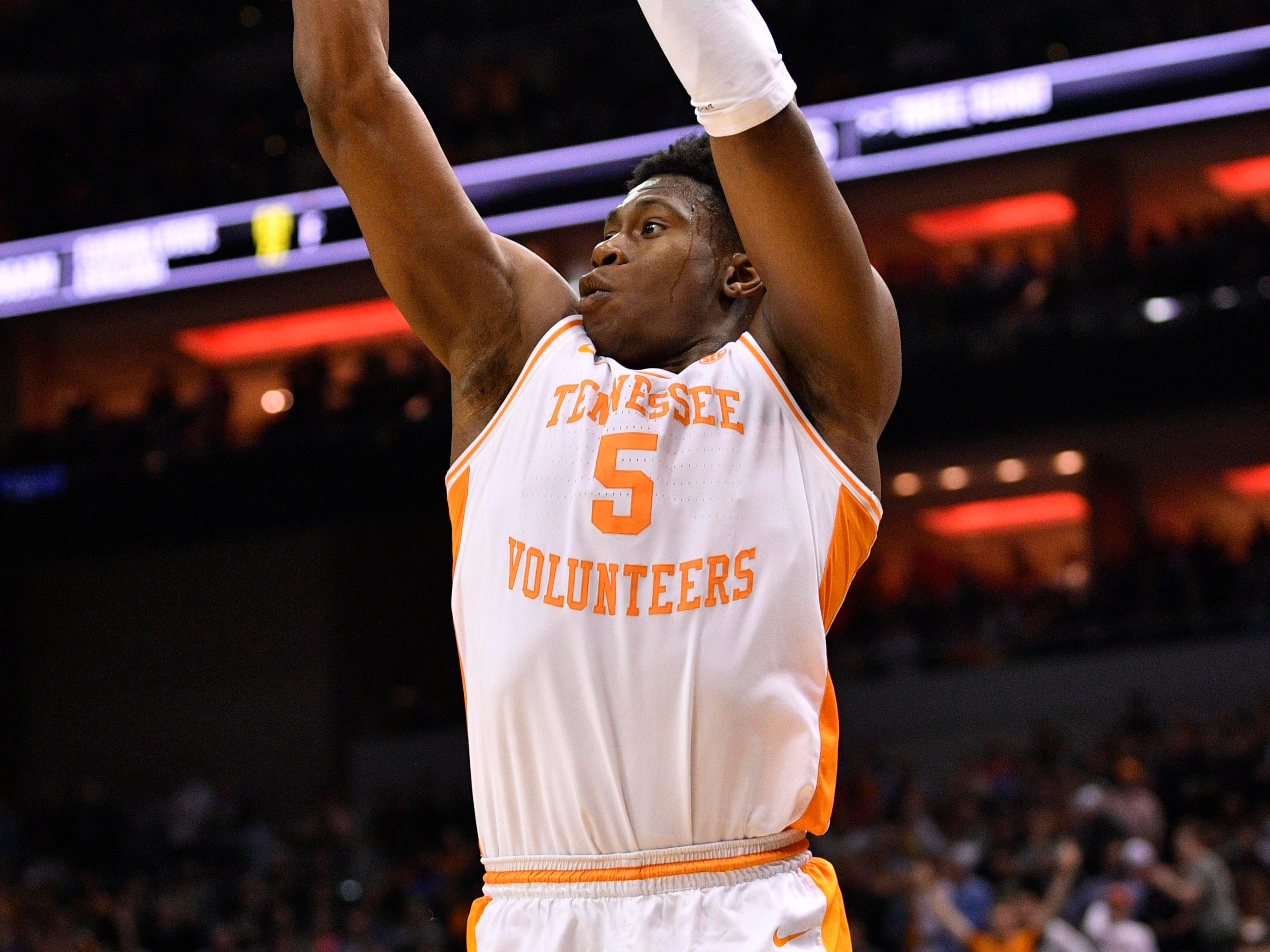 Mar 28, 2019; Louisville, KY, United States; Tennessee Volunteers guard Admiral Schofield (5) shoots during the second half in the semifinals of the south regional against the Purdue Boilermakers of the 2019 NCAA Tournament at KFC Yum Center. Mandatory Credit: Jamie Rhodes-USA TODAY Sports