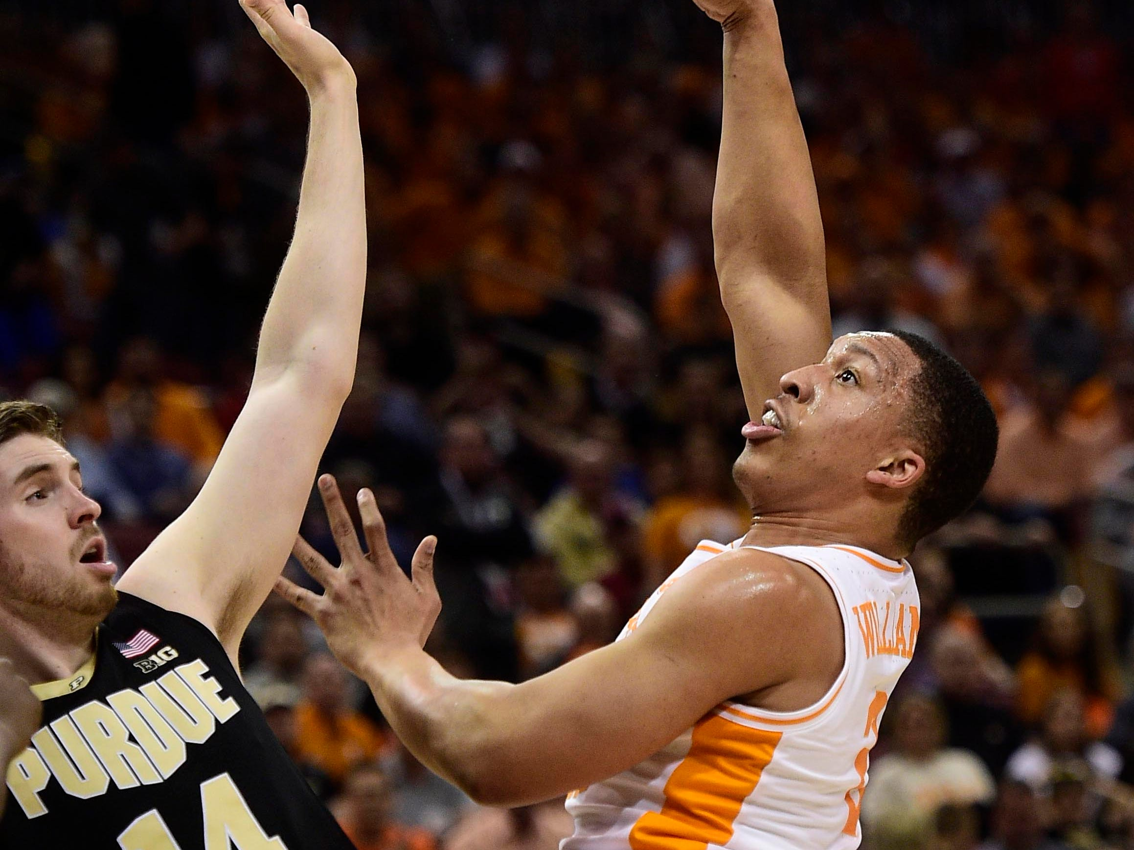 Mar 28, 2019; Louisville, KY, United States; Tennessee Volunteers forward Grant Williams (2) shoots as Purdue Boilermakers guard Ryan Cline (14) defends during the first half in the semifinals of the south regional of the 2019 NCAA Tournament at KFC Yum Center. Mandatory Credit: Thomas J. Russo-USA TODAY Sports