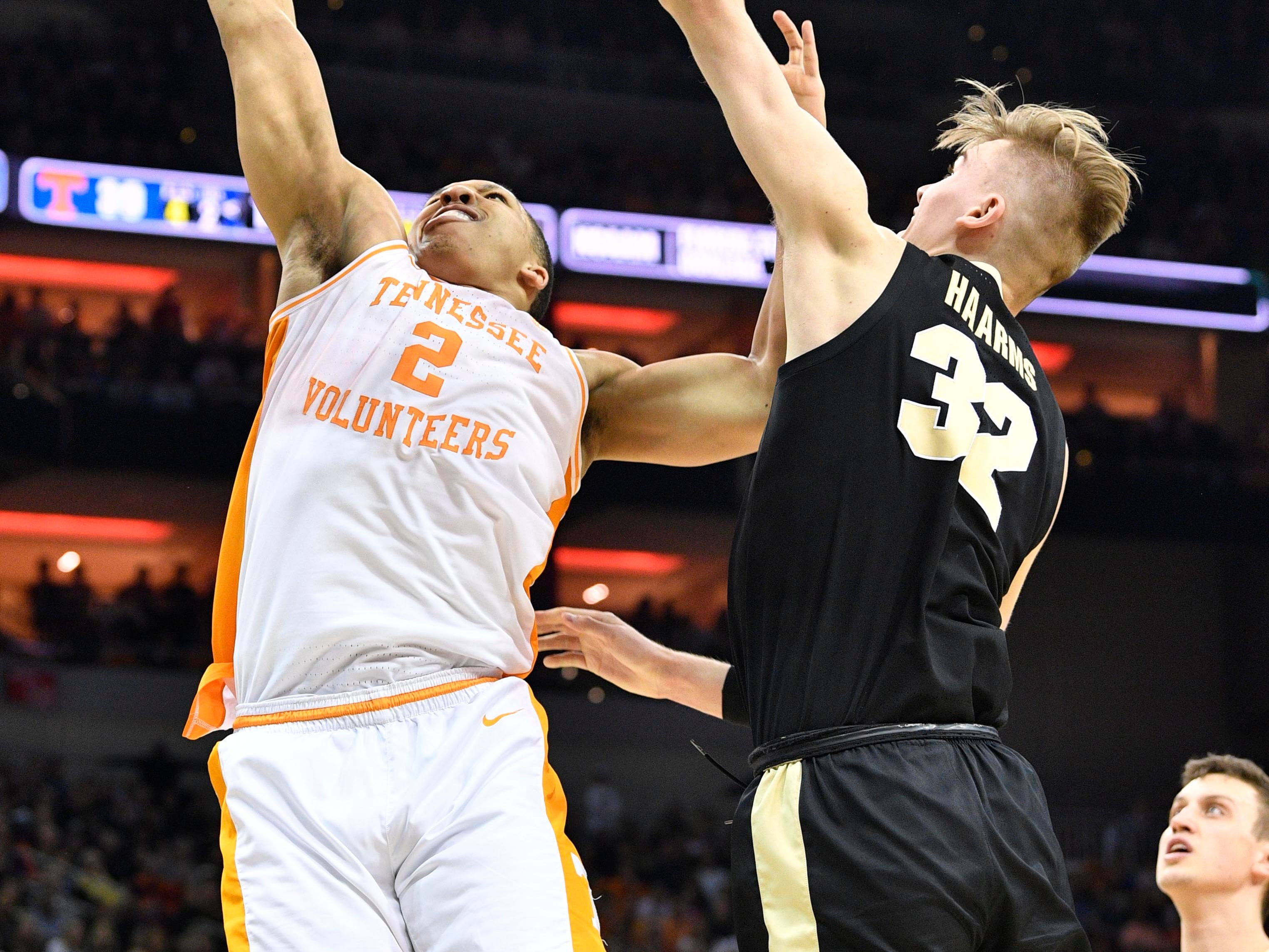 Mar 28, 2019; Louisville, KY, United States; Tennessee Volunteers forward Grant Williams (2) goes up for a shot as Purdue Boilermakers center Matt Haarms (32) defends during the second half in the semifinals of the south regional of the 2019 NCAA Tournament at KFC Yum Center. Mandatory Credit: Jamie Rhodes-USA TODAY Sports