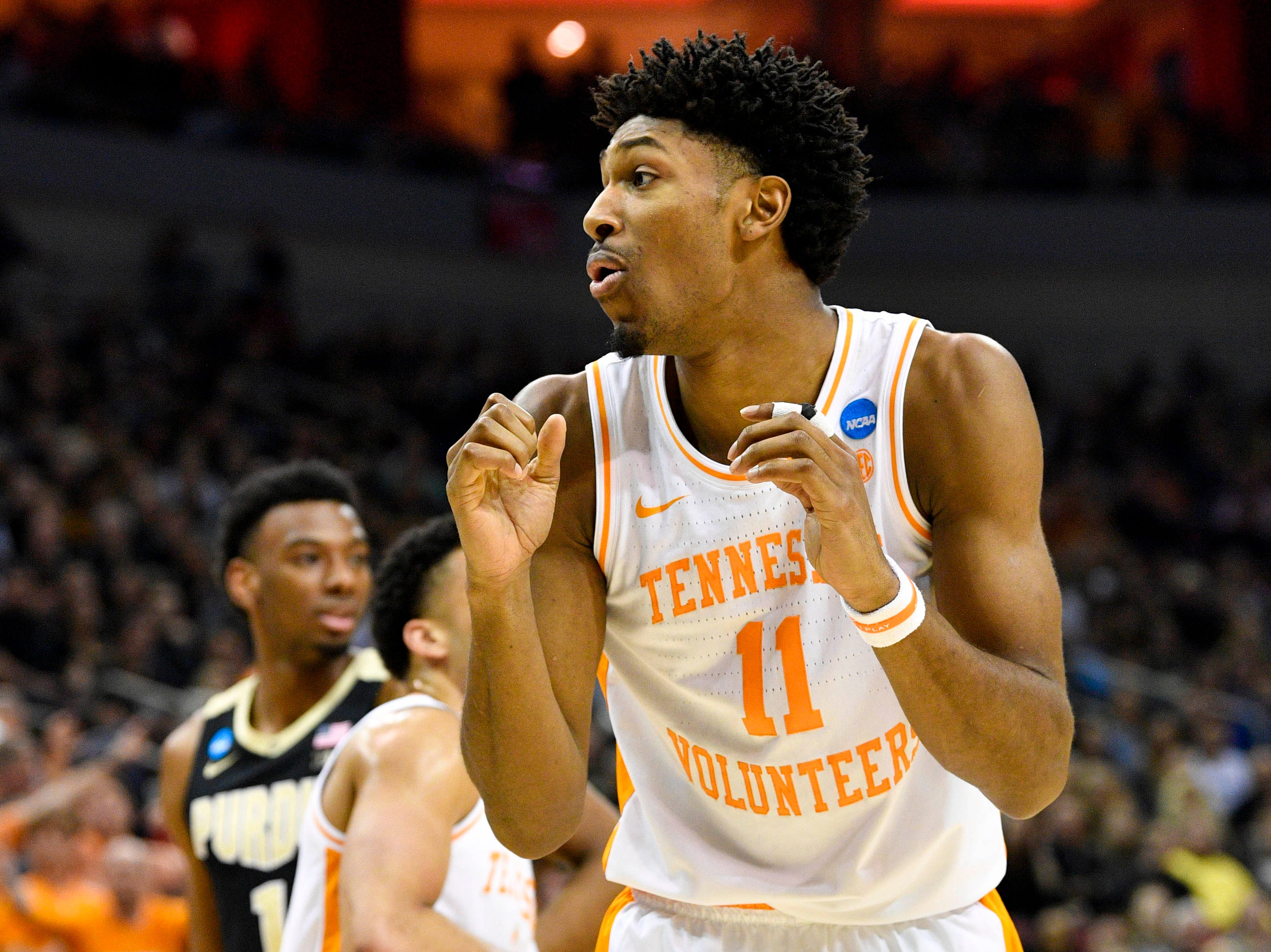 Mar 28, 2019; Louisville, KY, United States; Tennessee Volunteers forward Kyle Alexander (11) reacts during the first half in the semifinals of the south regional against the Purdue Boilermakers of the 2019 NCAA Tournament at KFC Yum Center. Mandatory Credit: Jamie Rhodes-USA TODAY Sports