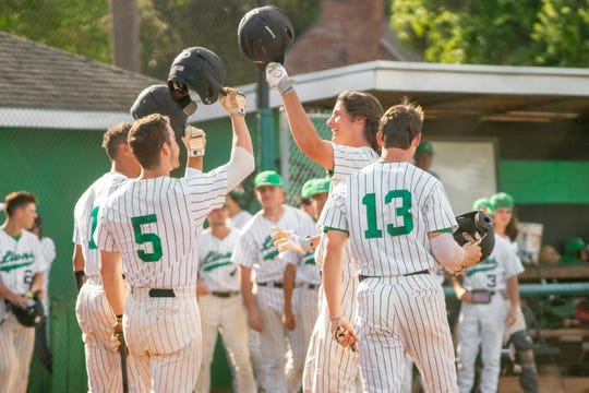 Lafayette High's Tyler LeBlanc celebrates with his teammates after his homerun hit as the Lafayette High Mighty Lions take on the Acadiana High Wreckin' Rams at home on Thursday, March 23, 2019.