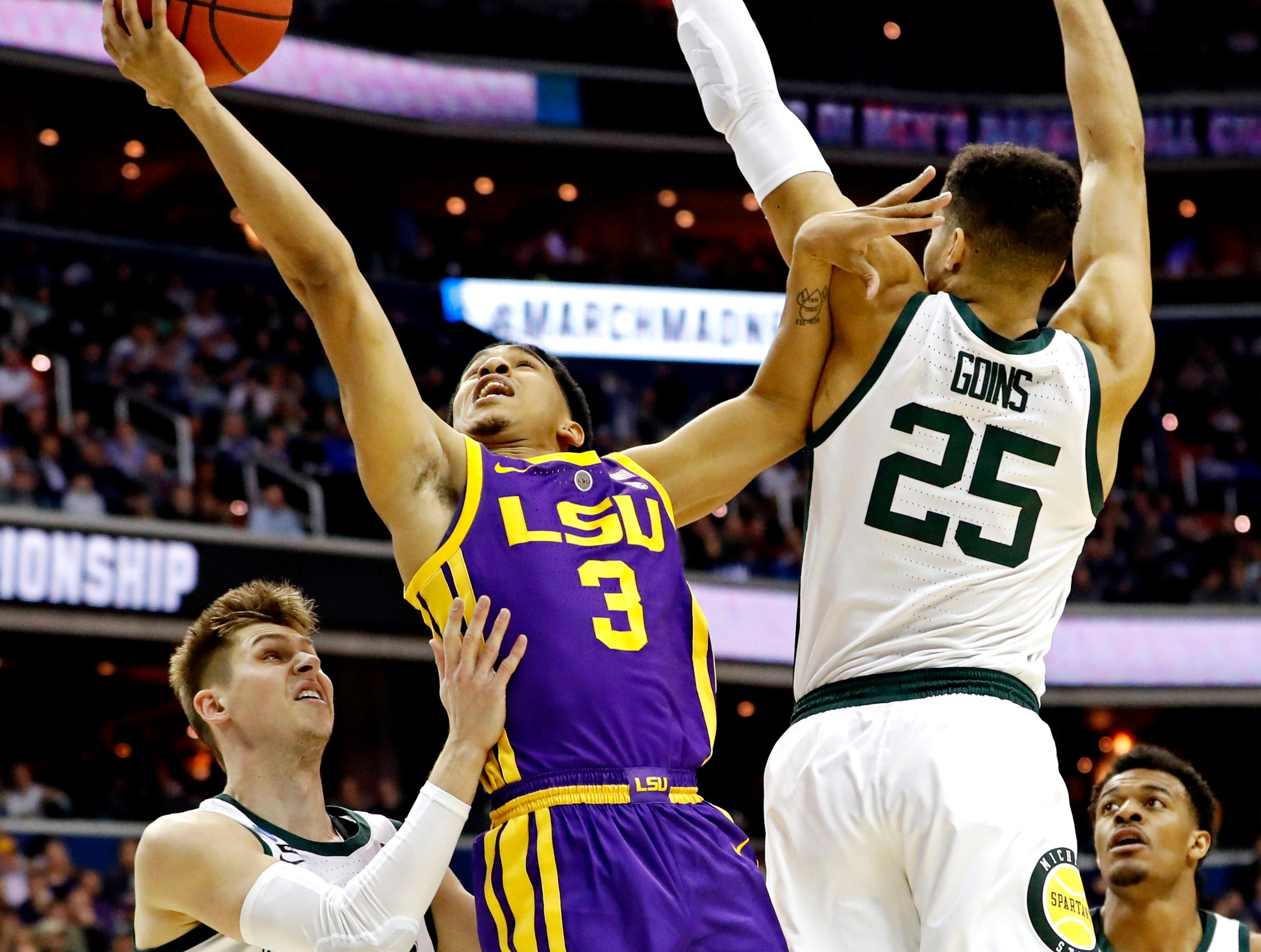 Mar 29, 2019; Washington, DC, USA; LSU Tigers guard Tremont Waters (3) shoots the ball against Michigan State Spartans forward Kenny Goins (25) and guard Matt McQuaid (20) during the first half in the semifinals of the east regional of the 2019 NCAA Tournament at Capital One Arena. Mandatory Credit: Geoff Burke-USA TODAY Sports
