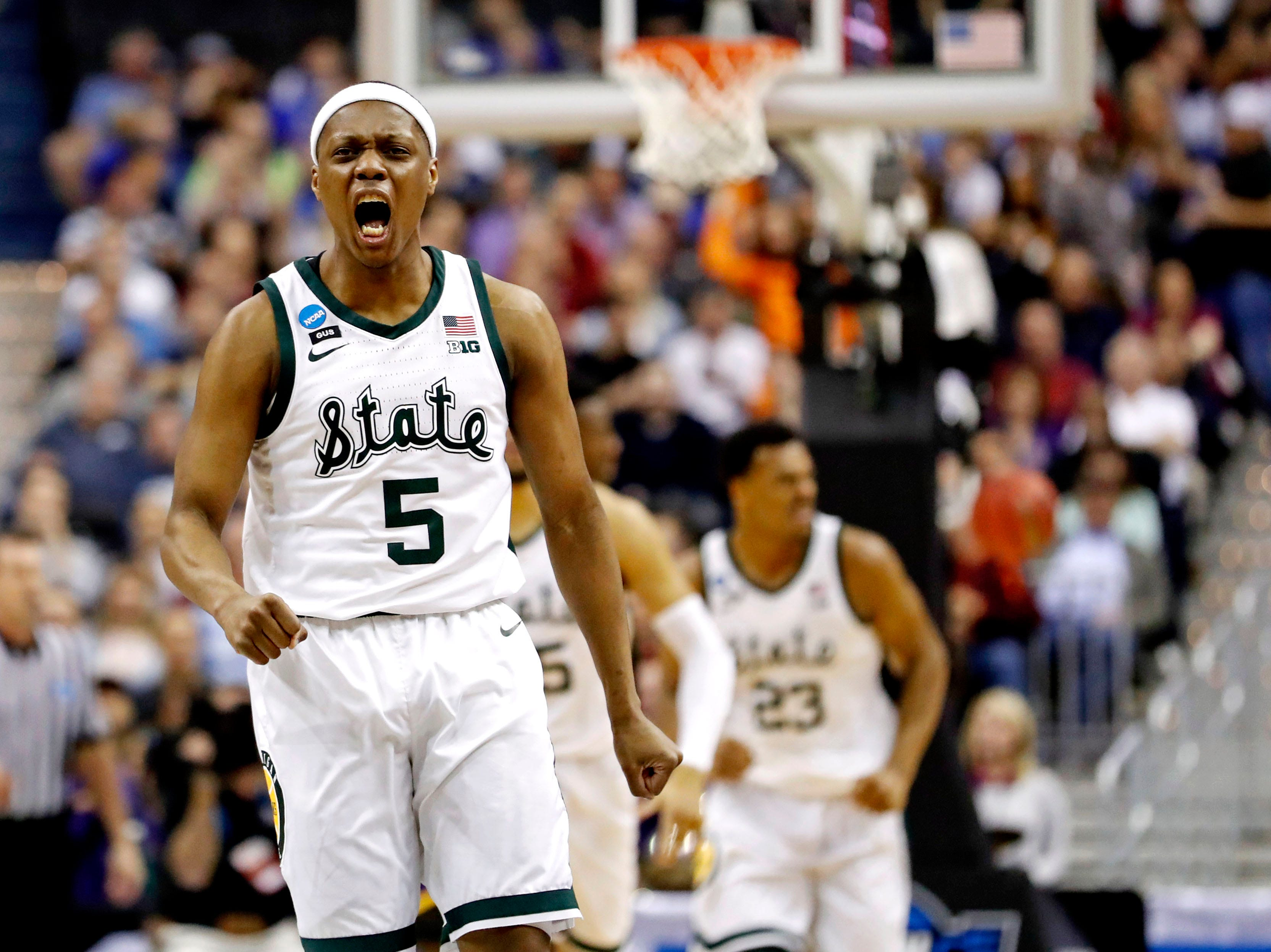 Mar 29, 2019; Washington, DC, USA; Michigan State Spartans guard Cassius Winston (5) reacts during the first half against the LSU Tigers in the semifinals of the east regional of the 2019 NCAA Tournament at Capital One Arena. Mandatory Credit: Geoff Burke-USA TODAY Sports