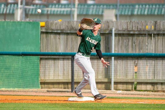 Acadiana High's Gavin Cox catches the throw to first base to get the runner out as the Lafayette High Mighty Lions take on the Acadiana High Wreckin' Rams at home on Thursday, March 23, 2019.