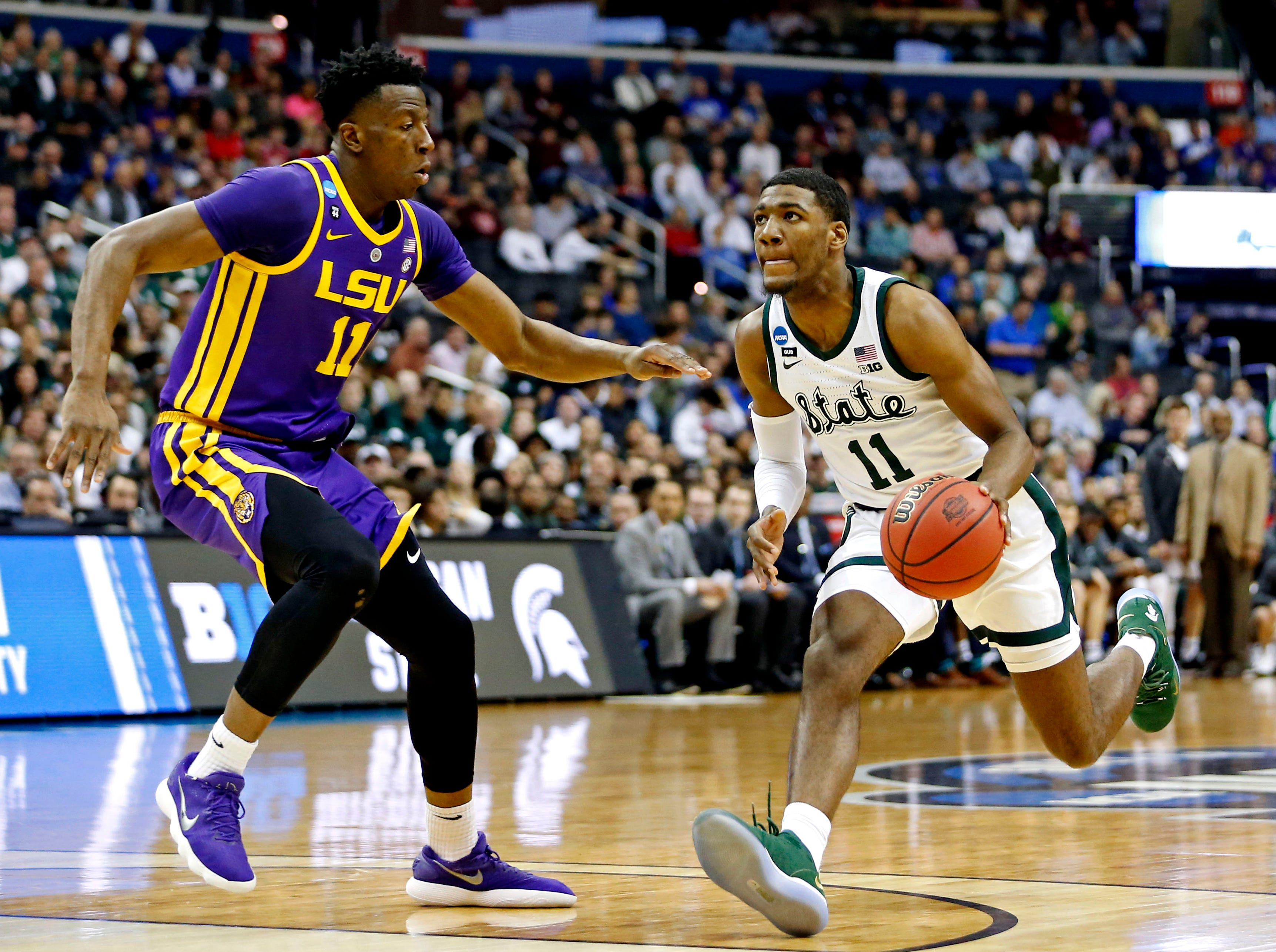 Mar 29, 2019; Washington, DC, USA; Michigan State Spartans forward Aaron Henry (11) drives to the basket against LSU Tigers forward Kavell Bigby-Williams (11) during the first half in the semifinals of the east regional of the 2019 NCAA Tournament at Capital One Arena. Mandatory Credit: Amber Searls-USA TODAY Sports