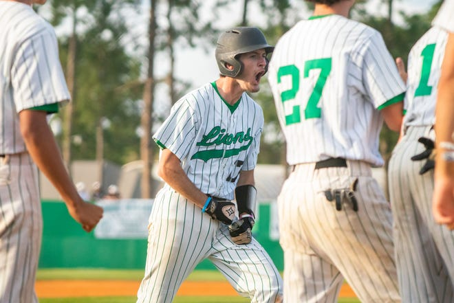 Lafayette High's Brock Miller celebrates his grand slam hit at home plate as the Lafayette High Mighty Lions take on the Acadiana High Wreckin' Rams at home on Thursday, March 23, 2019.