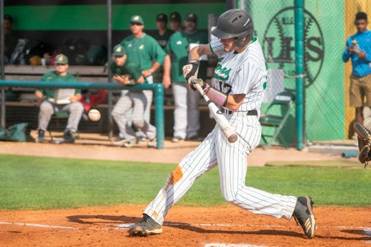 Lafayette High's Brock Miller swings at the incoming pitch as the Lafayette High Mighty Lions take on the Acadiana High Wreckin' Rams at home on Thursday, March 23, 2019.