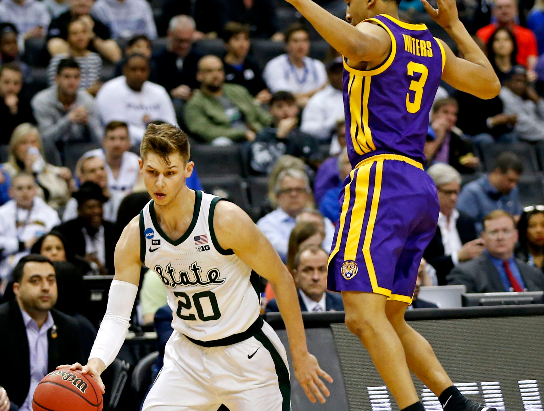 Mar 29, 2019; Washington, DC, USA; Michigan State Spartans guard Matt McQuaid (20) handles the ball against LSU Tigers guard Tremont Waters (3) during the first half in the semifinals of the east regional of the 2019 NCAA Tournament at Capital One Arena. Mandatory Credit: Amber Searls-USA TODAY Sports