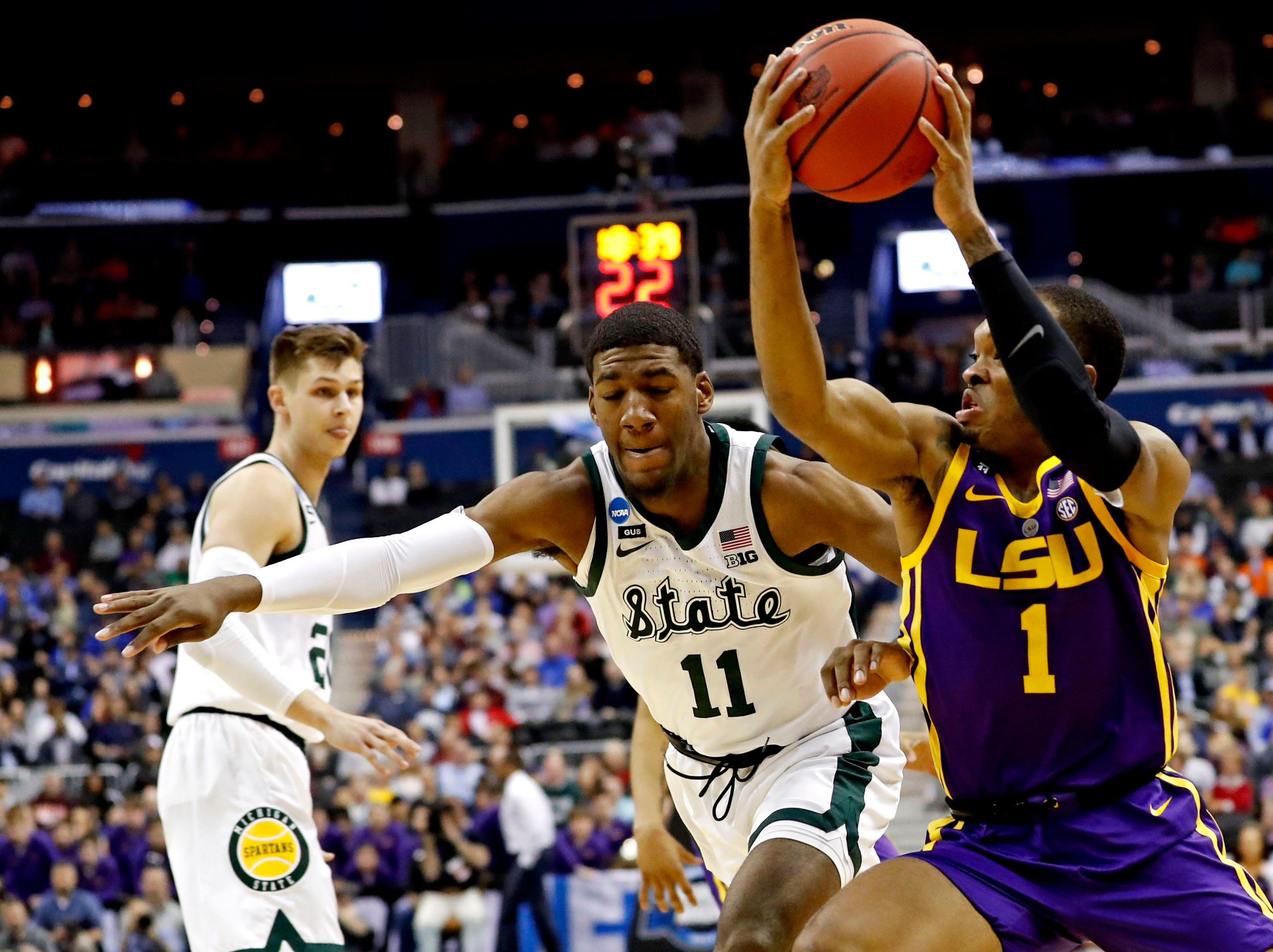 Mar 29, 2019; Washington, DC, USA; LSU Tigers guard Javonte Smart (1) drives to the basket against Michigan State Spartans forward Aaron Henry (11) during the first half in the semifinals of the east regional of the 2019 NCAA Tournament at Capital One Arena. Mandatory Credit: Geoff Burke-USA TODAY Sports