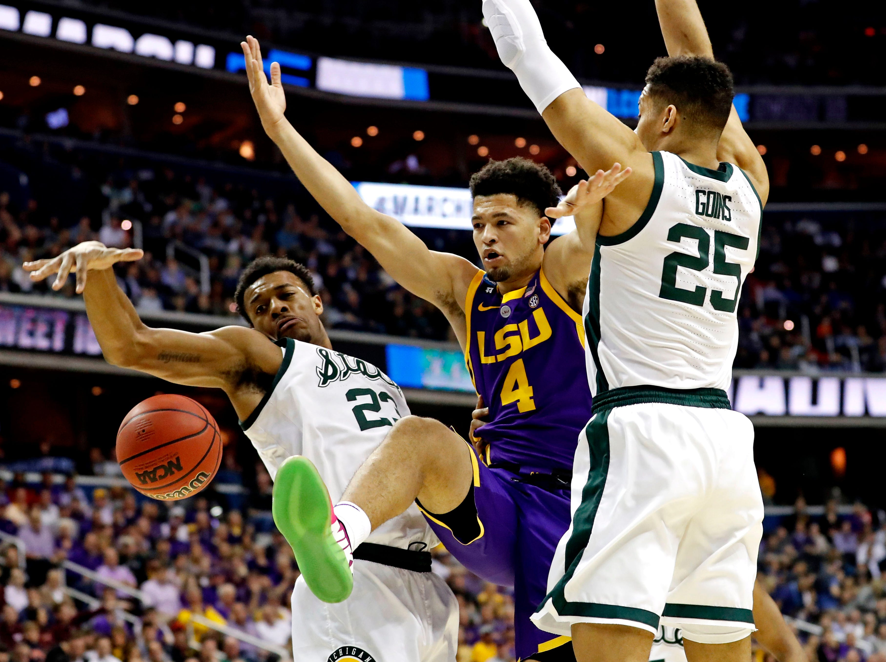 Mar 29, 2019; Washington, DC, USA; LSU Tigers guard Skylar Mays (4) drives to the basket against Michigan State Spartans forward Xavier Tillman (23) and forward Kenny Goins (25) during the first half in the semifinals of the east regional of the 2019 NCAA Tournament at Capital One Arena. Mandatory Credit: Geoff Burke-USA TODAY Sports