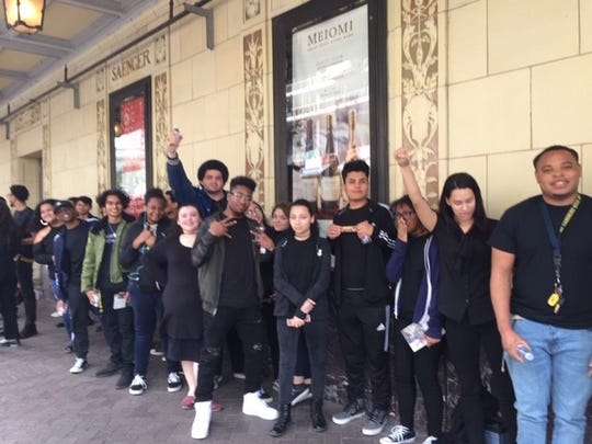 """Carencro High students got to see """"Hamilton: An American Musical"""" at the Saenger Theater in New Orleans Friday. Students spent the morning working with actors before watching a matinee. They wore black to recreate the iconic silhouette photo of the Broadway show."""