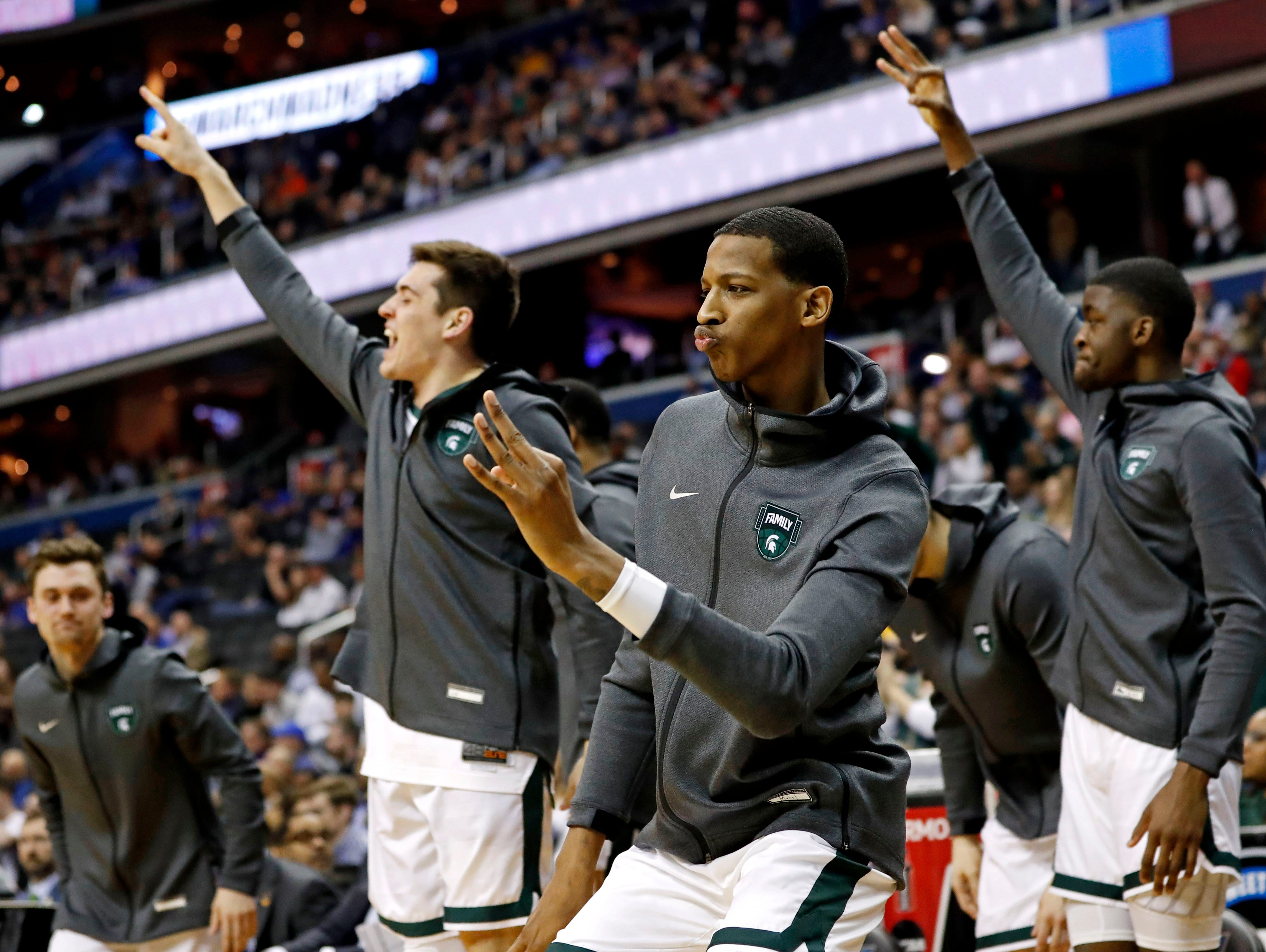 Mar 29, 2019; Washington, DC, USA; The Michigan State Spartans bench celebrates during the first half against the LSU Tigers in the semifinals of the east regional of the 2019 NCAA Tournament at Capital One Arena. Mandatory Credit: Geoff Burke-USA TODAY Sports