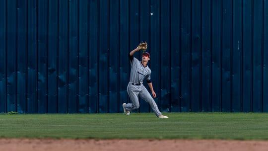 Josh Stevenson makes a catch as Teurlings Catholic host St Thomas More baseball. Thursday, March 28, 2019.