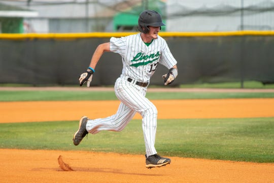 Lafayette High's Brock Miller sprints to third base as the Lafayette High Mighty Lions take on the Acadiana High Wreckin' Rams at home on Thursday, March 23, 2019.