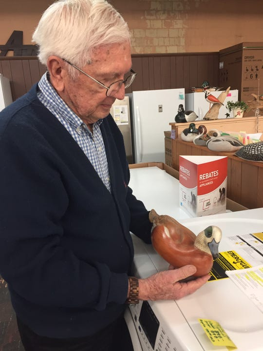 Good Housekeeping Shop owner Dave Miller likes to make wooden birds in his spare time. At 89, Miller works at the store six days a week and puts in 50 to 60 hours weekly. The business opened in 1933.